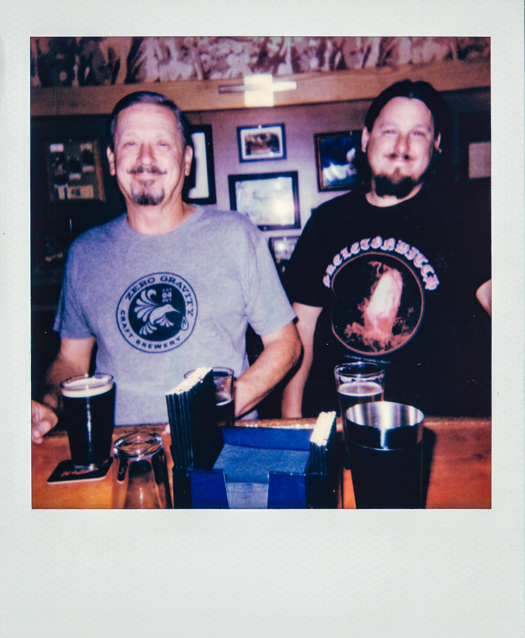 Father and Son Drinking at Wallys Mills Avenue Liquors Bar.