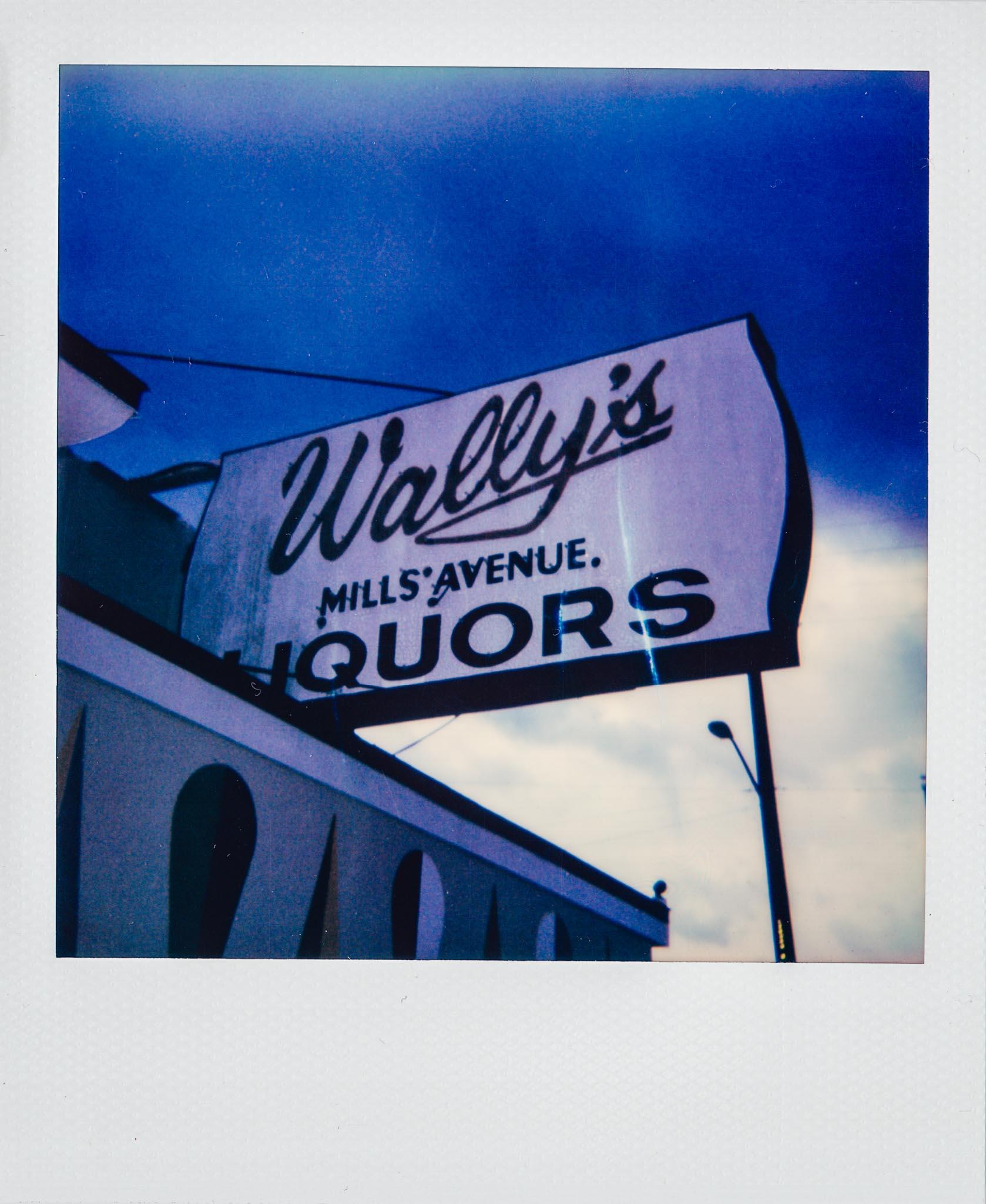 Polaroid of Wally's Mills Avenue Liquors Outdoor Sign