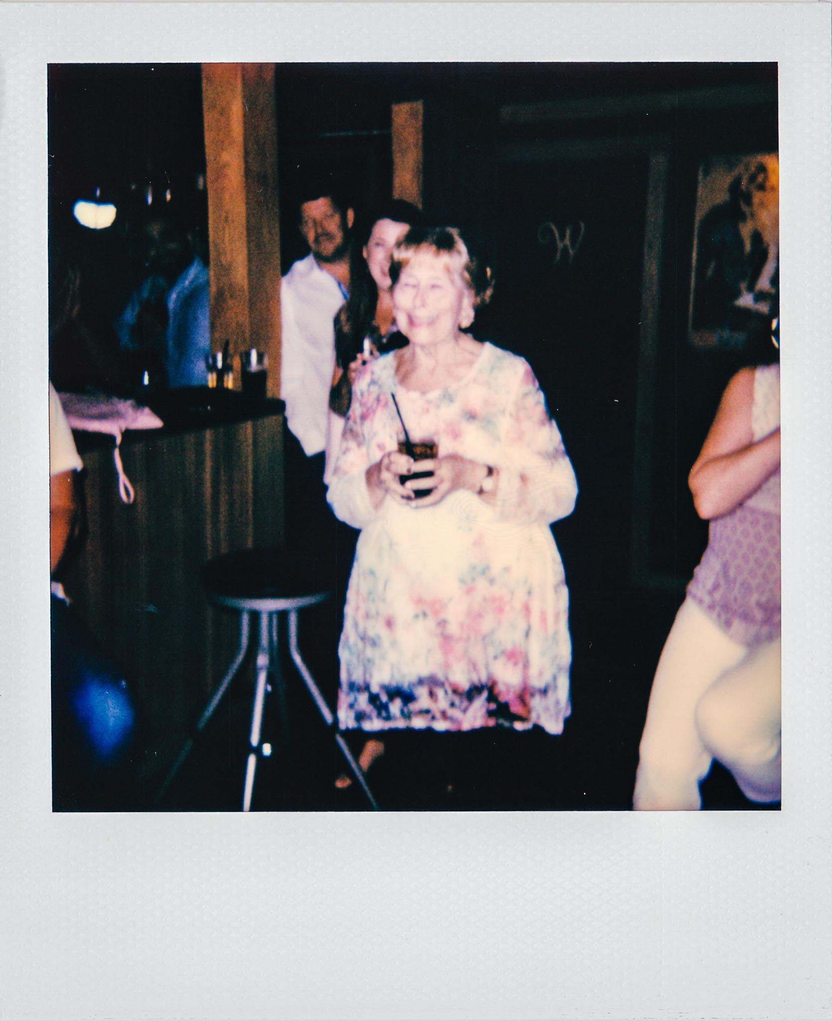 Linda Updike giving a toast at Wallys Mills Avenue Liquors