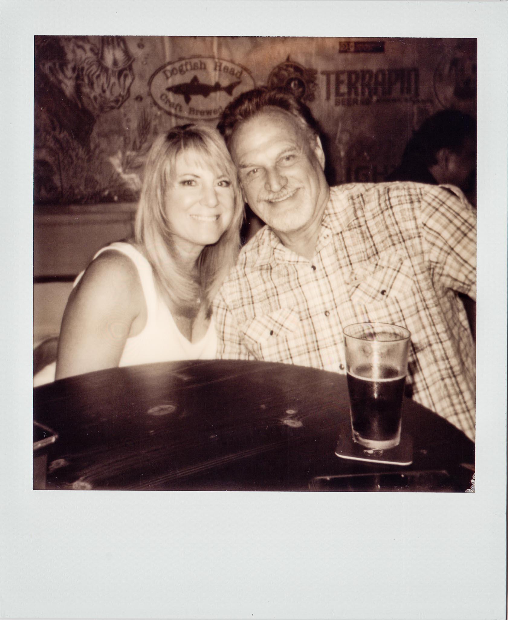 Couple enjoying a drink at Wallys Mills Avenue Liquors