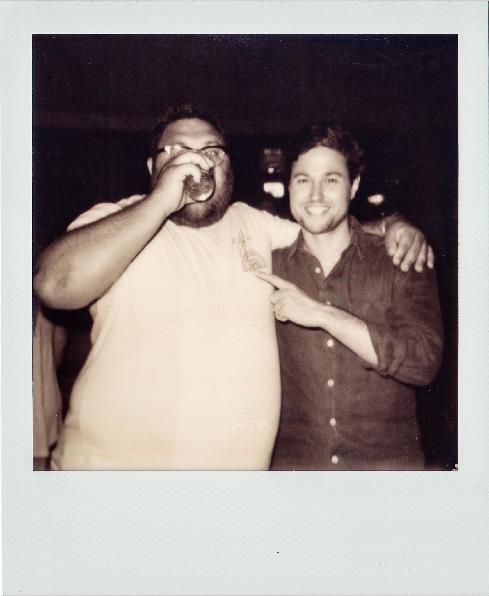 Jordan Eichenblatt having a drink while his friend points at him