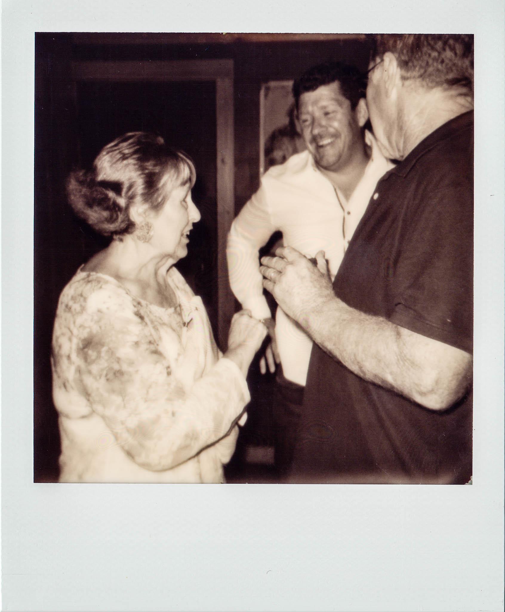 Linda Updike talking with friends at Wallys Mills Avenue Liquors.