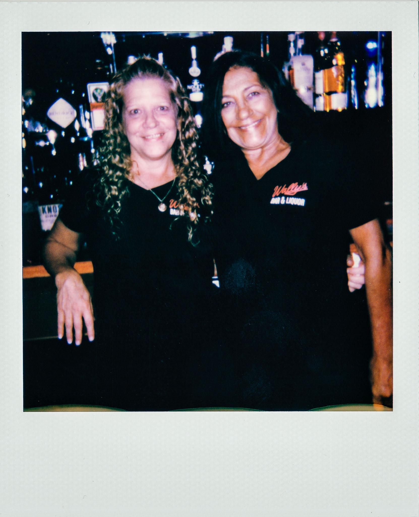 Two female bartenders at Wallys Mills Avenue Liquors