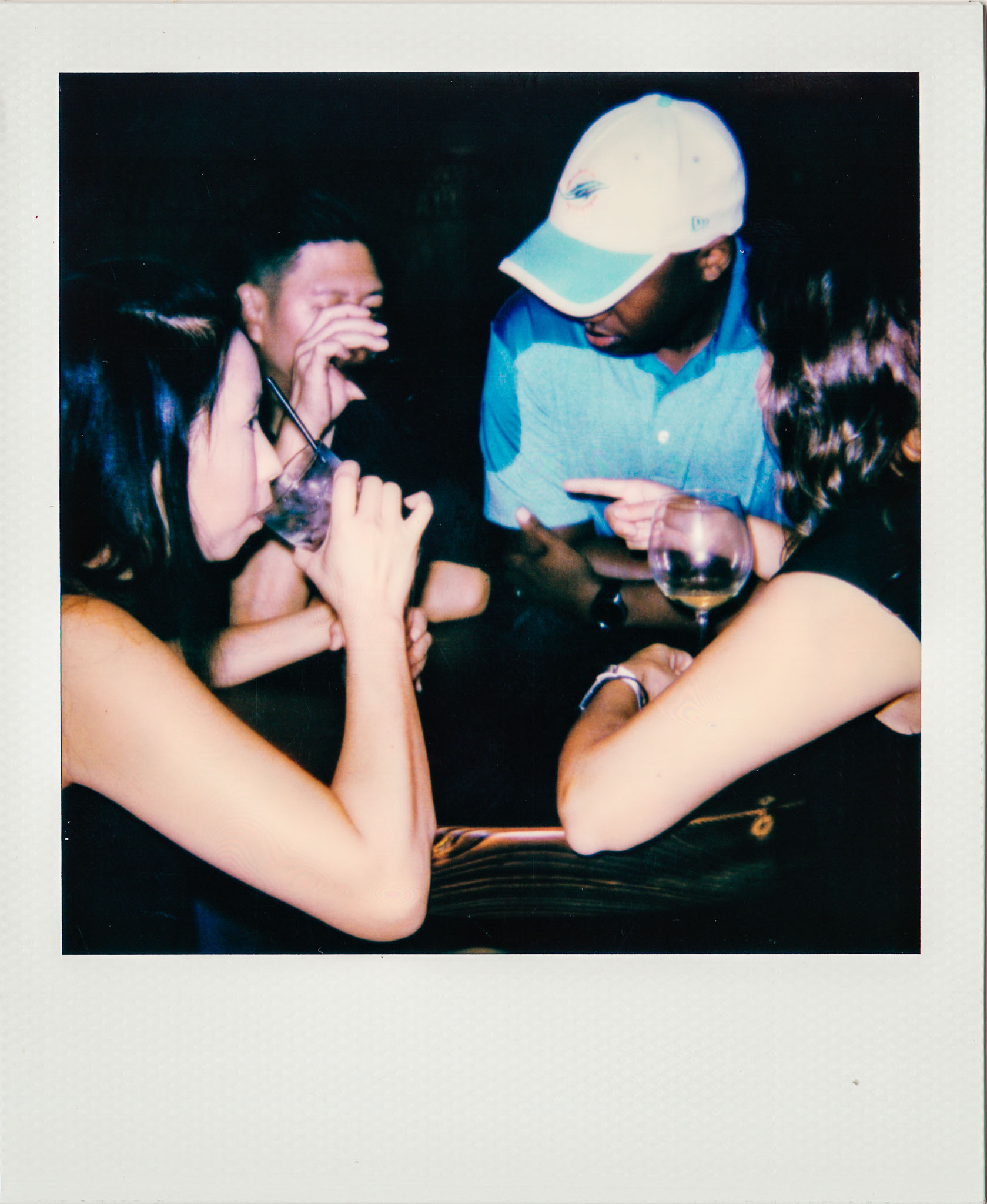 customers-drinking-wallys-polaroid.jpg