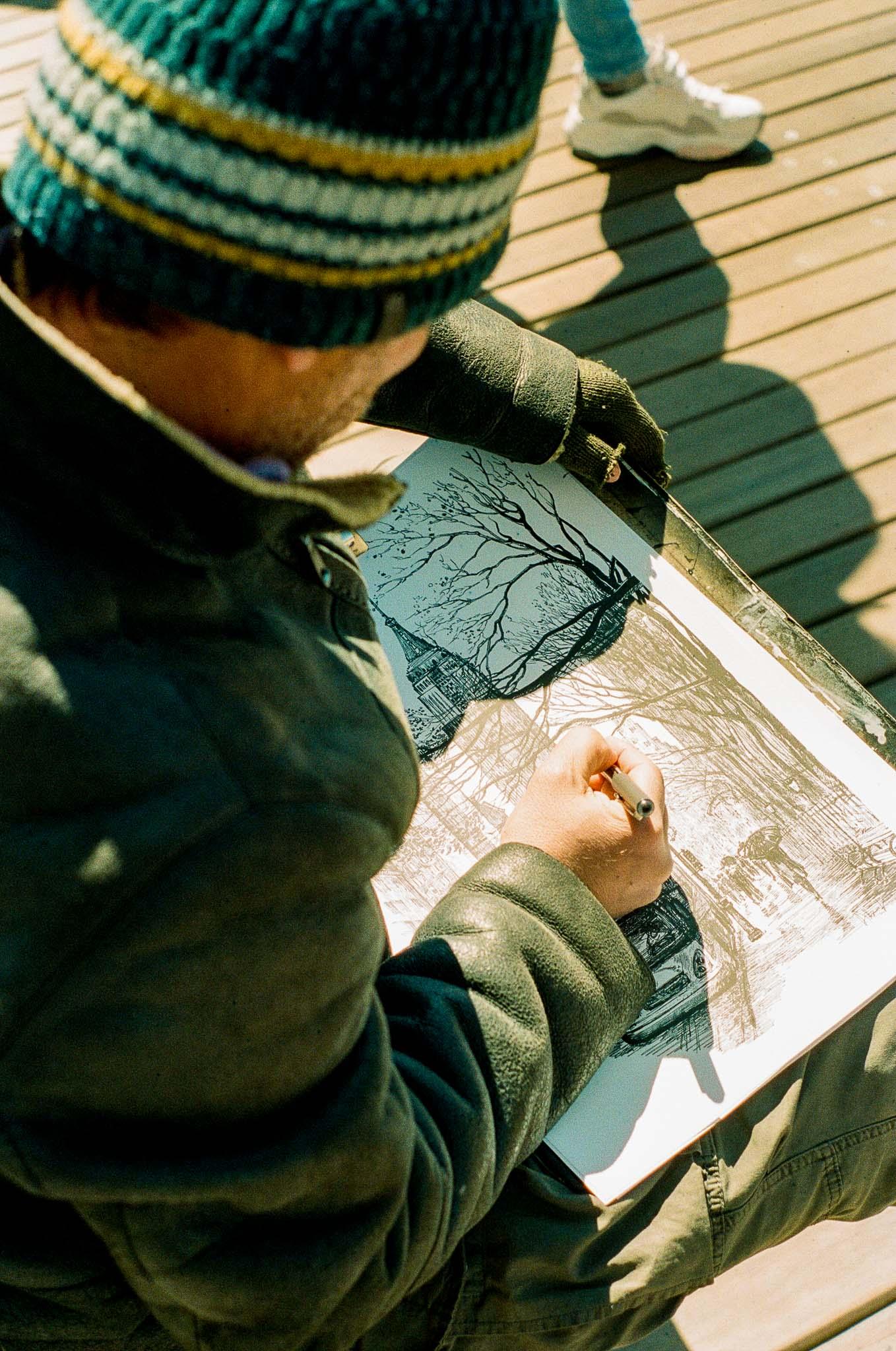 Artist-Drawing-Brooklyn-Bridge.jpg