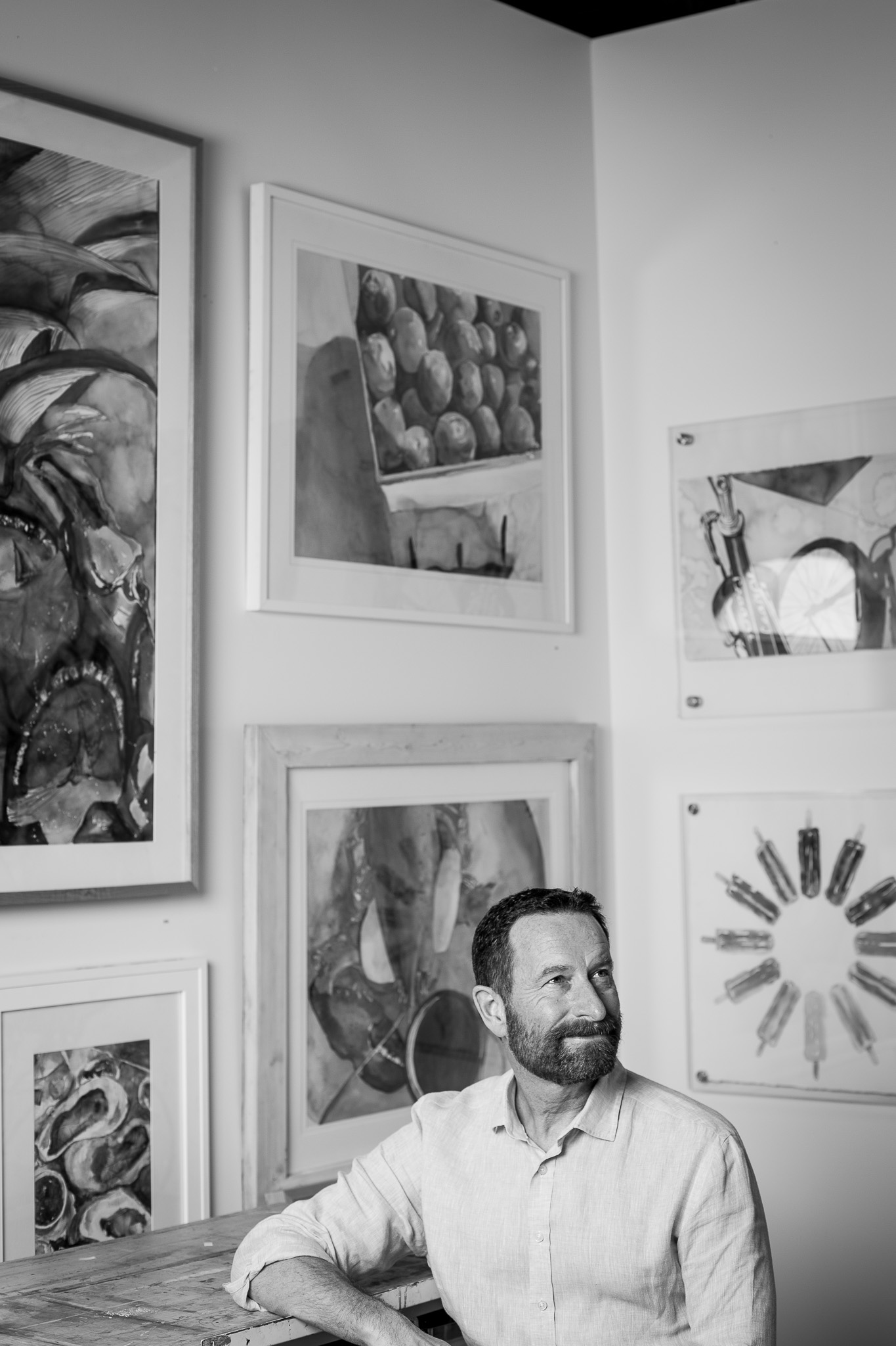 Duncan Wardle sitting in an art studio gazing of to the side.