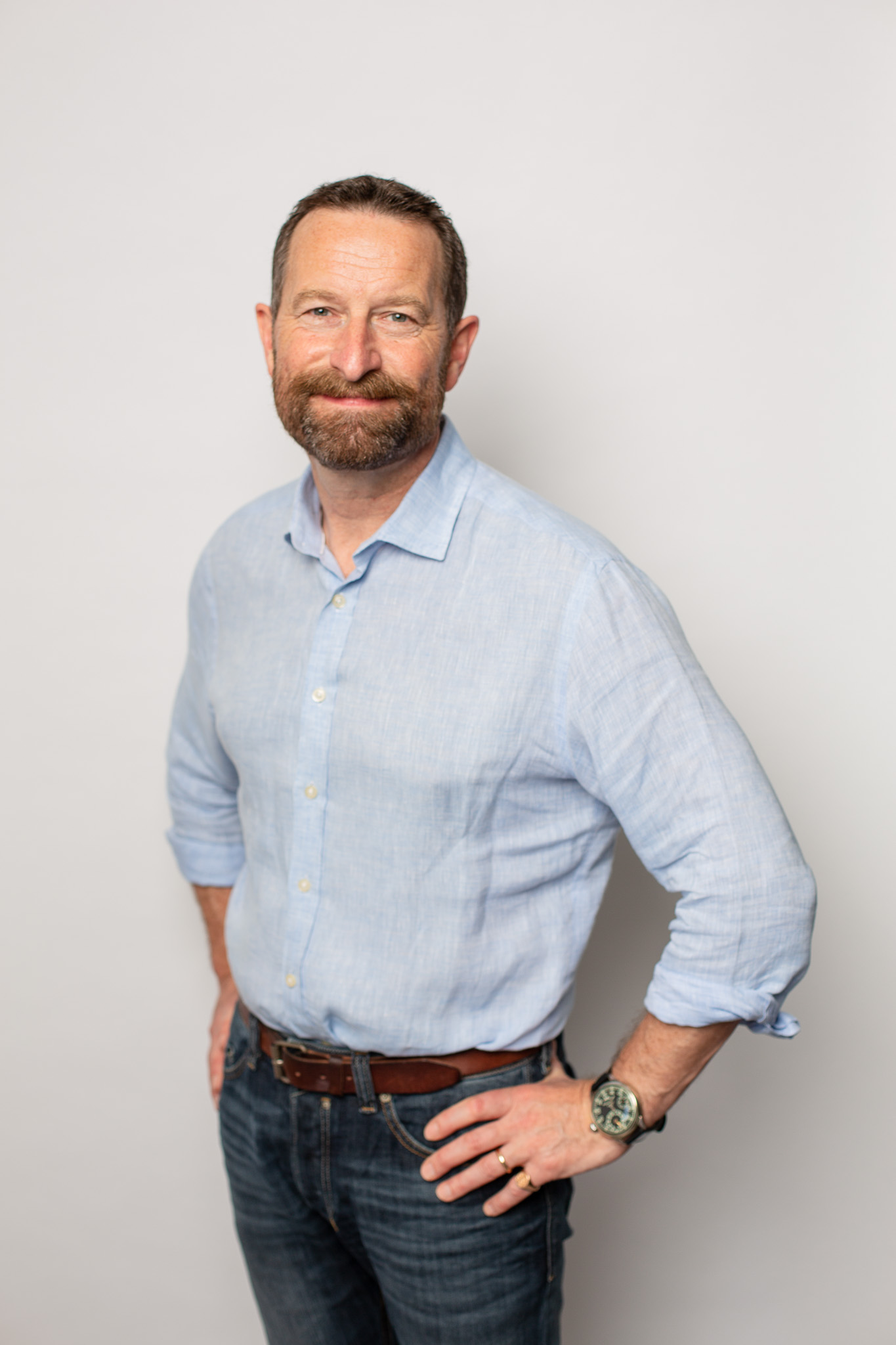 Duncan Wardle on a white backdrop in a blue shirt