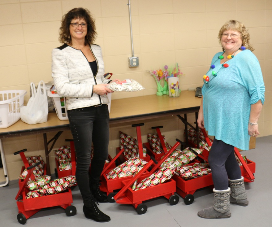 Kiwanis members organizing the gifts for the boys.
