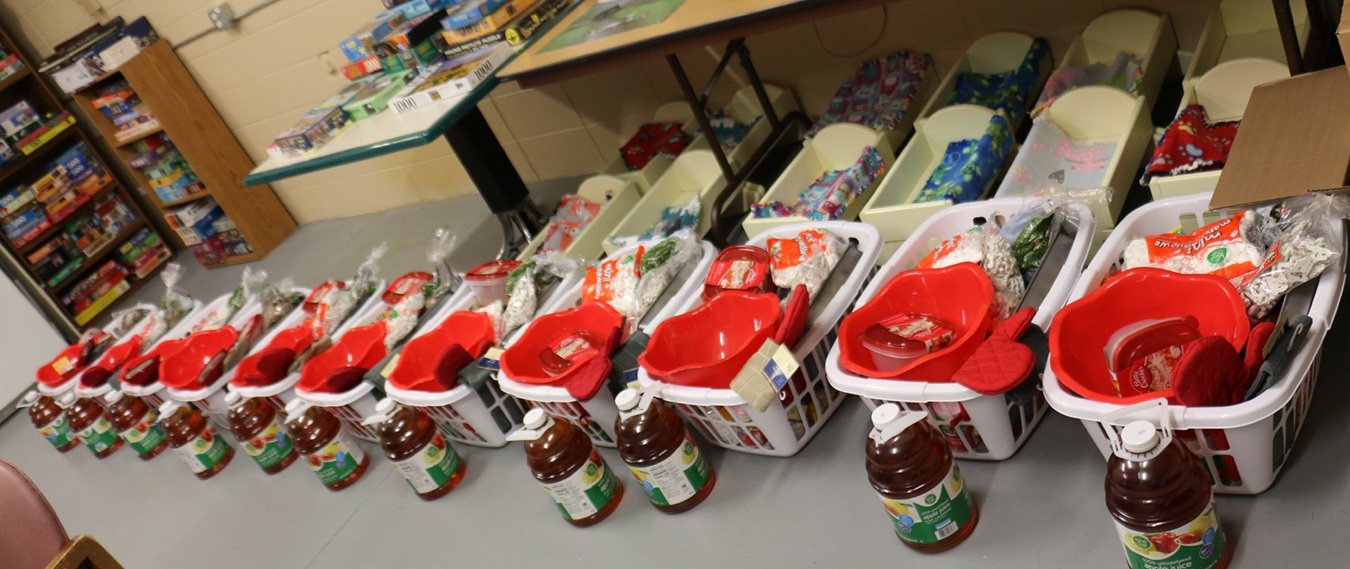 Each family received an overflowing basket of food for a Christmas dinner, thanks to the donation from Plenco.