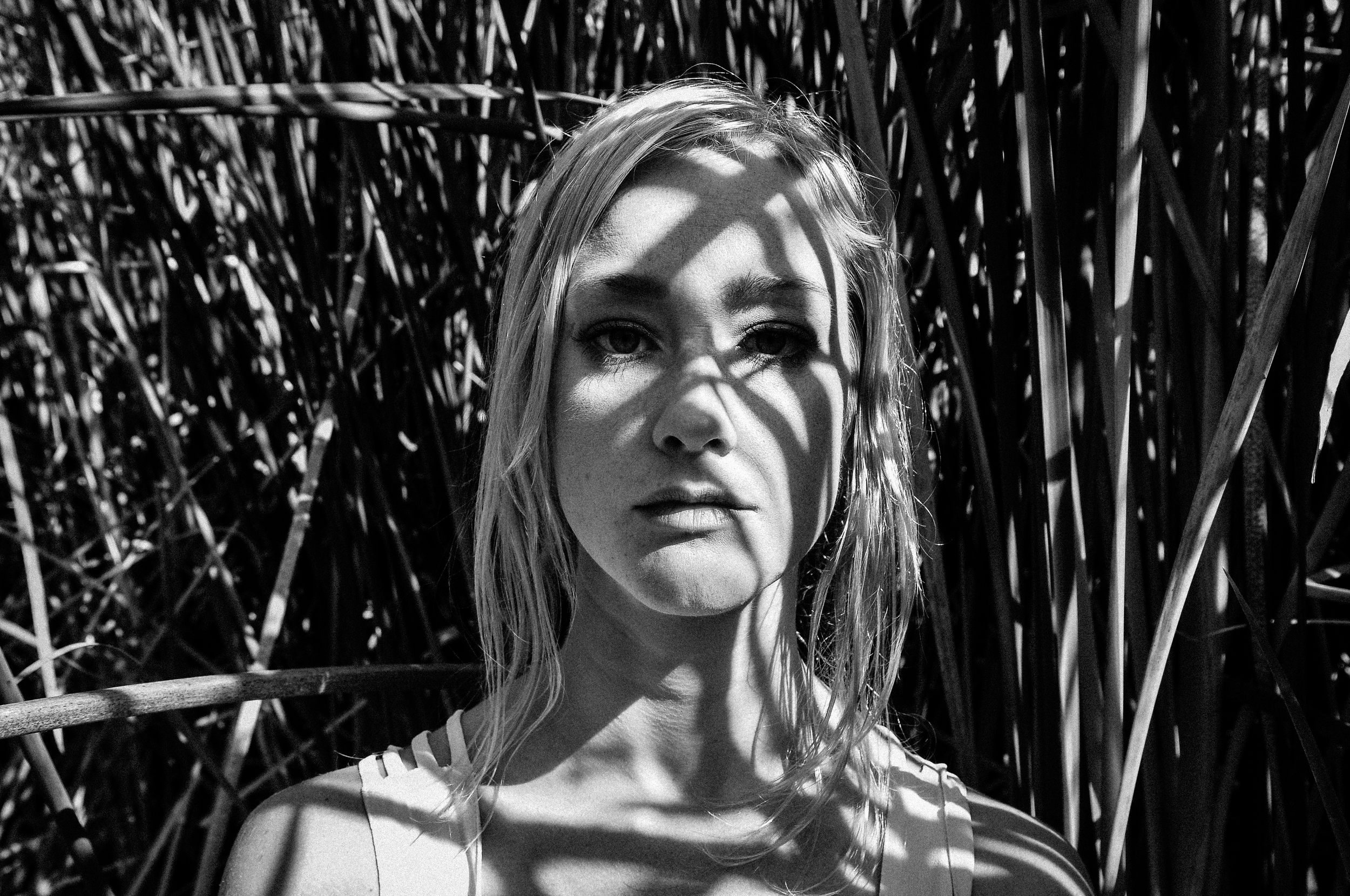 black and white, ashley marie myers, shadows, portrait, portrait of a woman, woman portrait, shadows on the face,