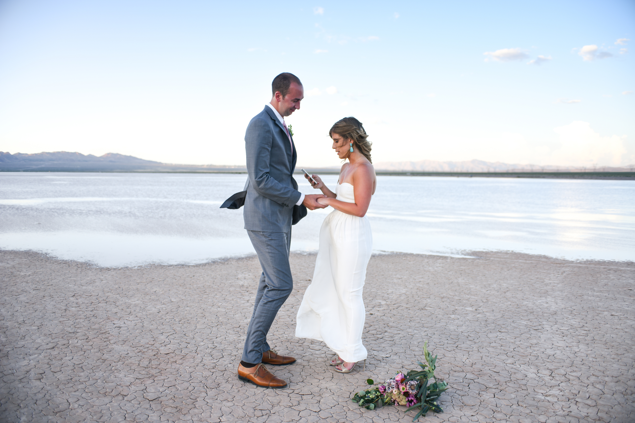 dry lake bed wedding, desert wedding, pop up wedding, elopement, las vegas elopement, desert elopement, flora pop elopement, ashley marie myers, lifestyle photography, lifestyle wedding, surprise wedding, surprise elopement, dry lake beds, las vegas,