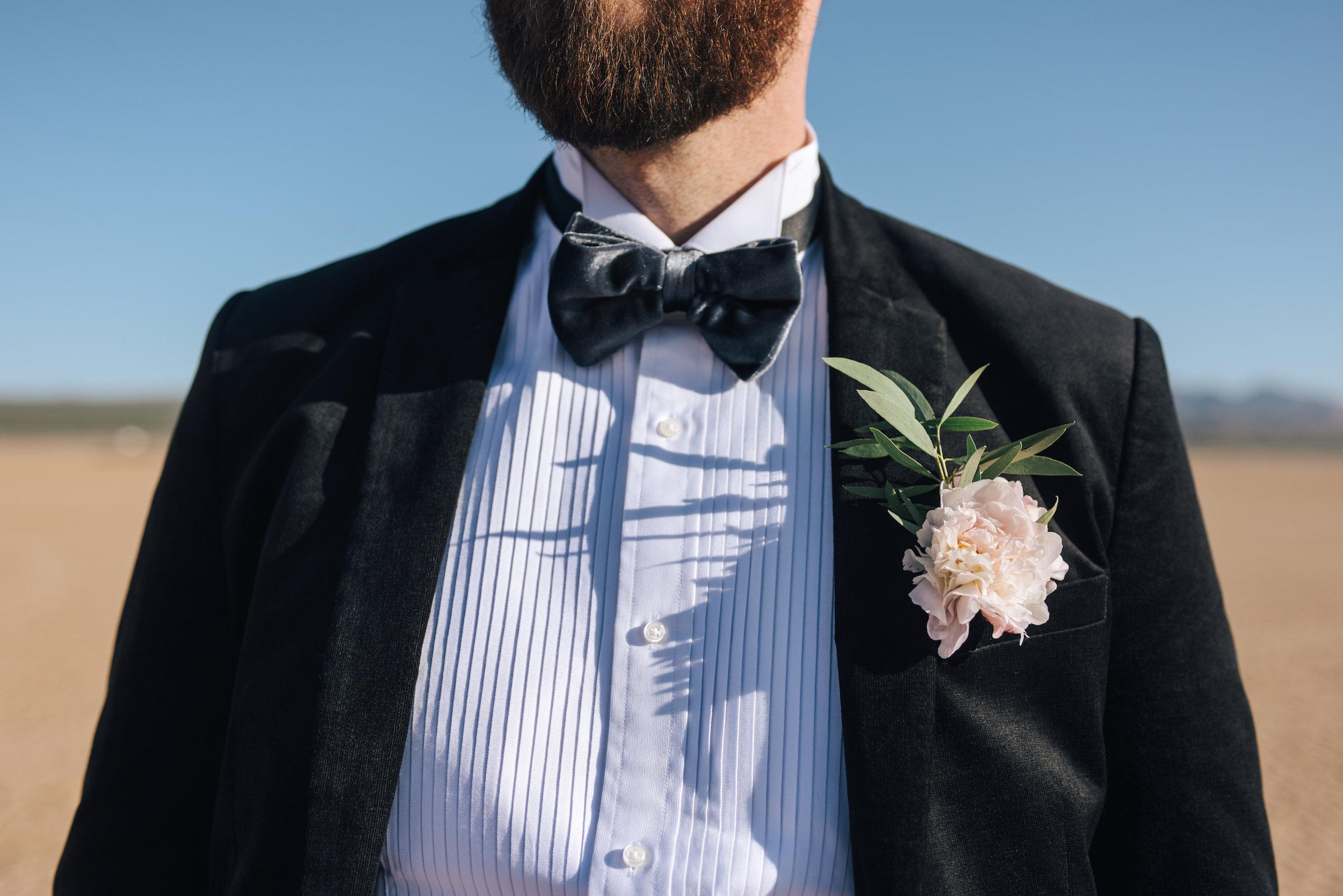 bride and groom, groom, flora pop ceremony, flora pop, bride, las vegas wedding, las vegas elopement, elopement, elope, dry lake bed wedding, lifestyle photography, las vegas, flowers, bridal flowers, wedding dress, wedding, elope