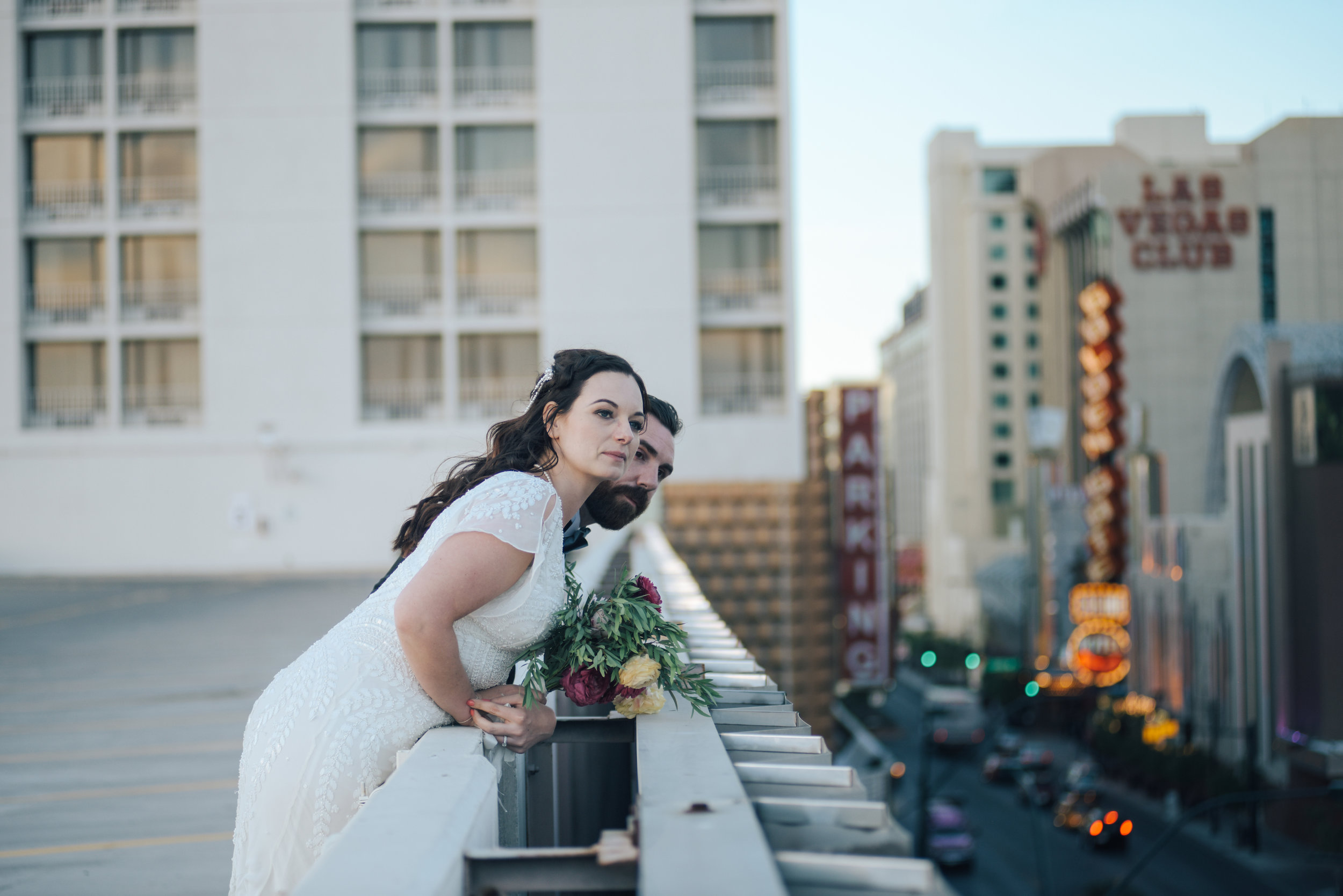 downtown las vegas, downtown wedding, downtown elopement, bride and groom, groom, flora pop ceremony, flora pop, bride, las vegas wedding, las vegas elopement, elopement, elope, dry lake bed wedding, lifestyle photography, las vegas, flowers, bridal flowers, wedding dress, wedding, elope