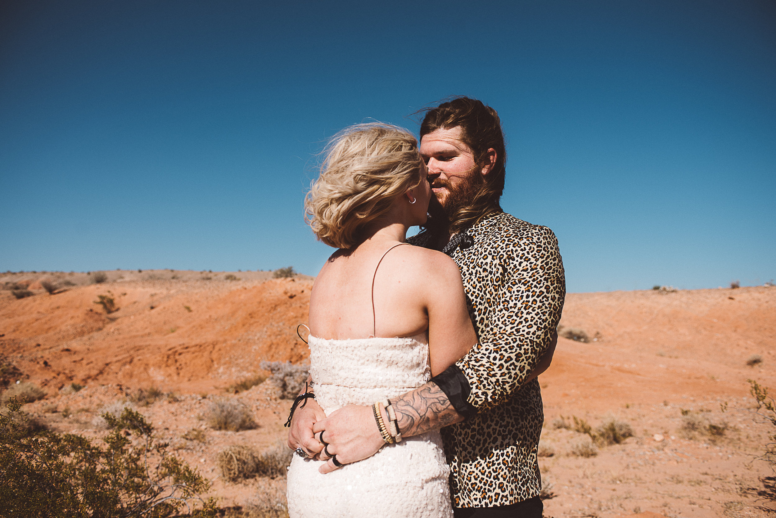 las vegas elopement, elope, rock'n roll bride, bride and groom, elvis wedding, pop up wedding, wedding, tattooed bride, tattoos, las vegas photographer, lifestyle photography, elopement inspiration, desert wedding, babe, marilyn monroe, aerial, drone photography, desert, ashley marie myer