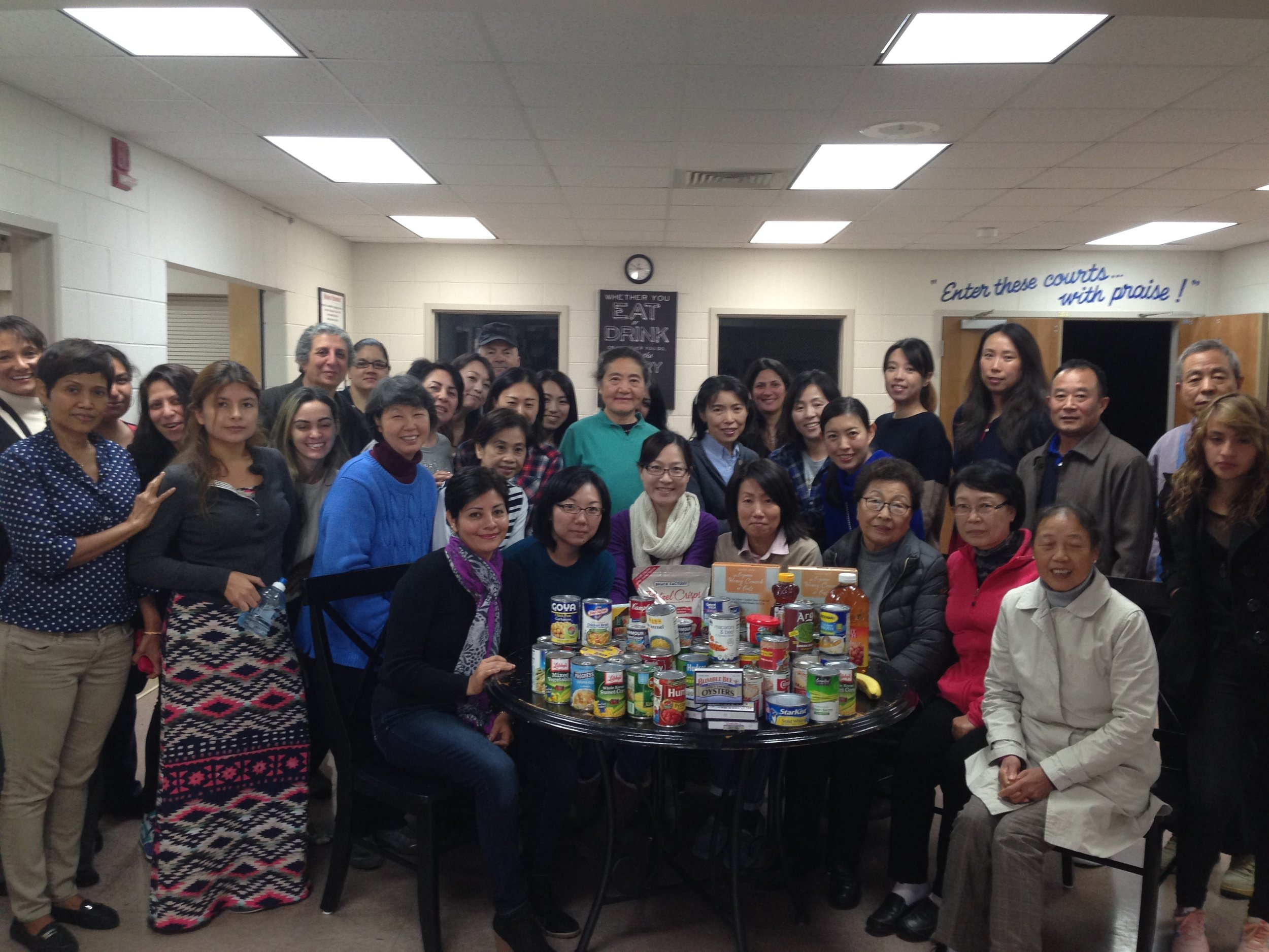 Yorktown Adult Education ESL students gathering for a canned food fundraiser in collaboration with Bethel Baptist Church.