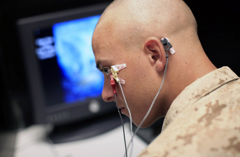 U.S. marines undergo testing for PTSD symptoms and predisposition—including eye blink monitoring—but treatments remain mostly ineffective. (AP Photo/Jae C. Hong)