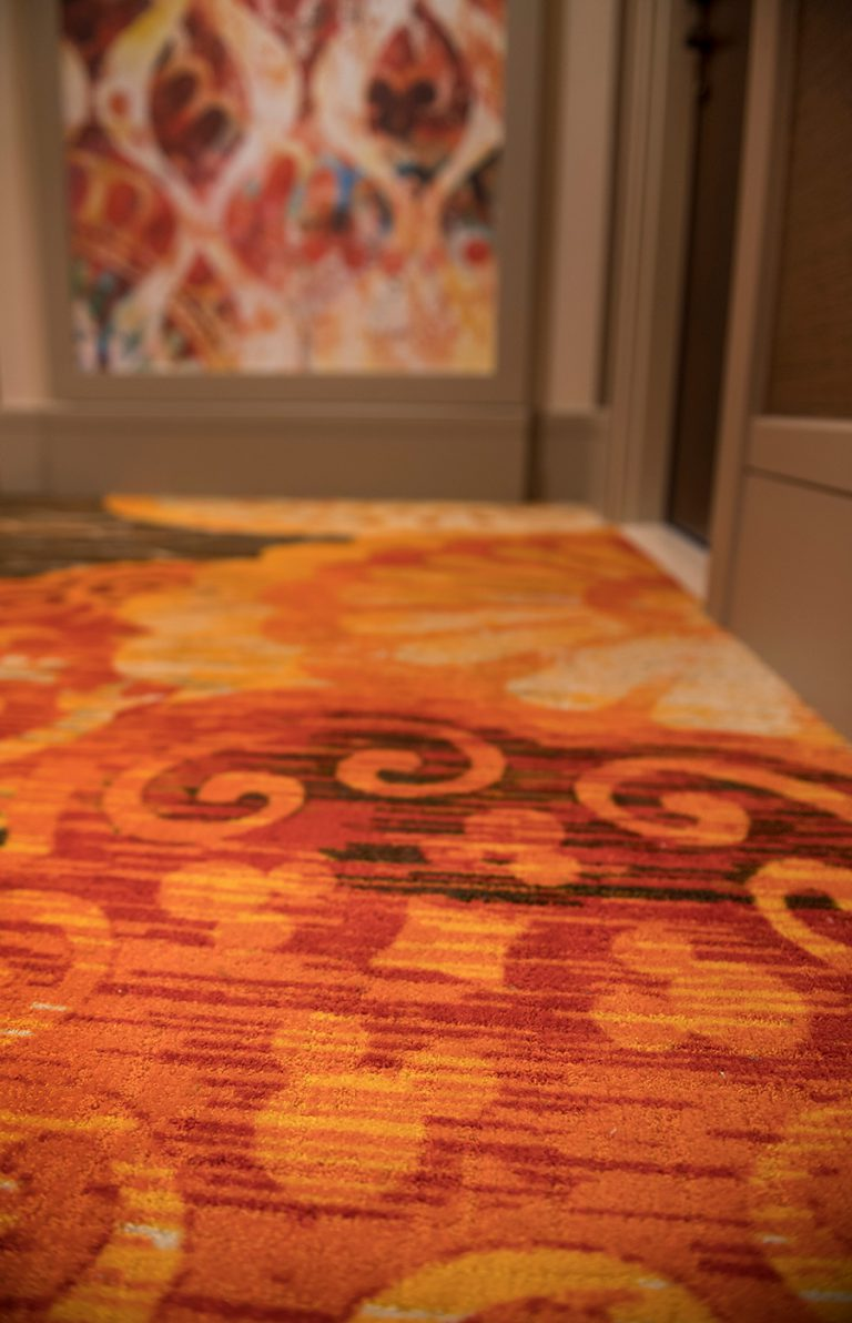 And after a day of adventure, on the way to the Gran Destino Tower bedrooms, you'll  see colorful art panels in a variety of patterns inspired by Spanish tiles as well as flooring with a special Disney touch.