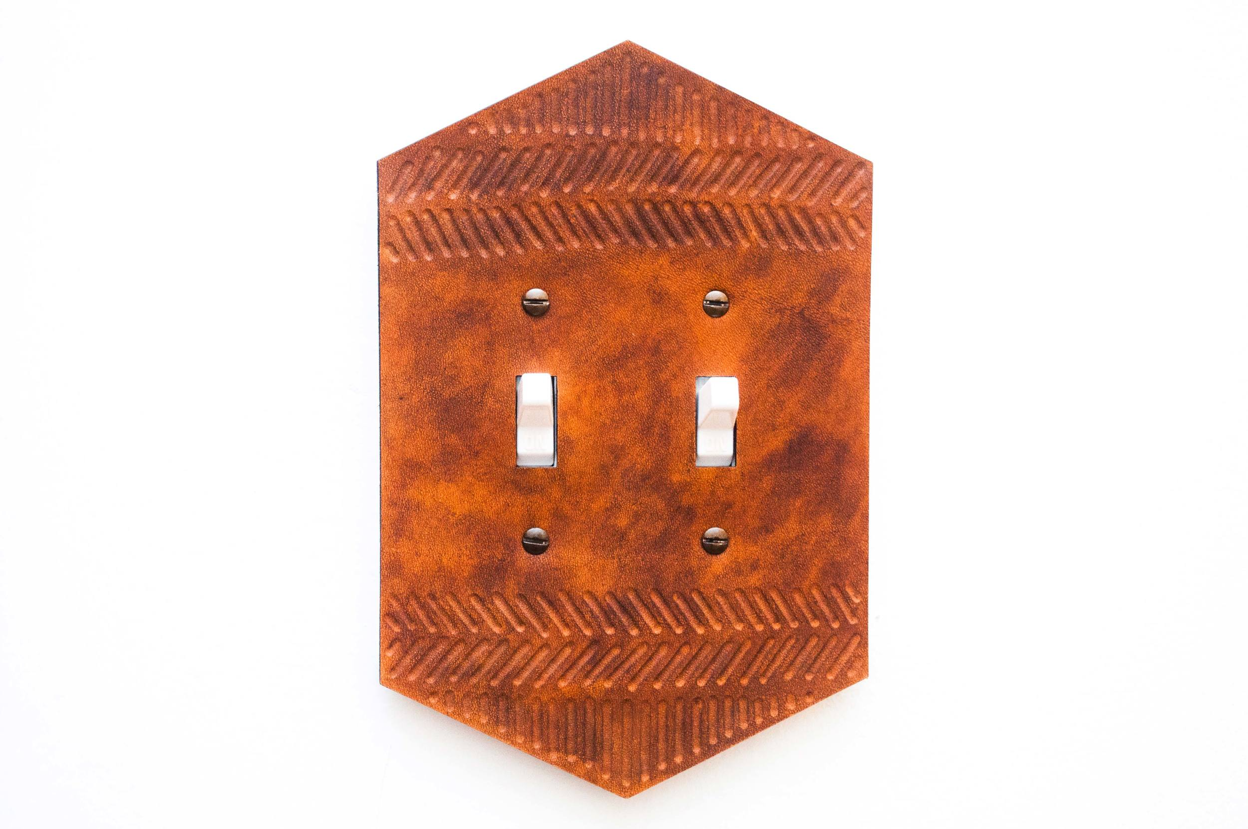 Canoe hand tooled leather light switch plate at Salt & Time Butcher Shop & Salumeria