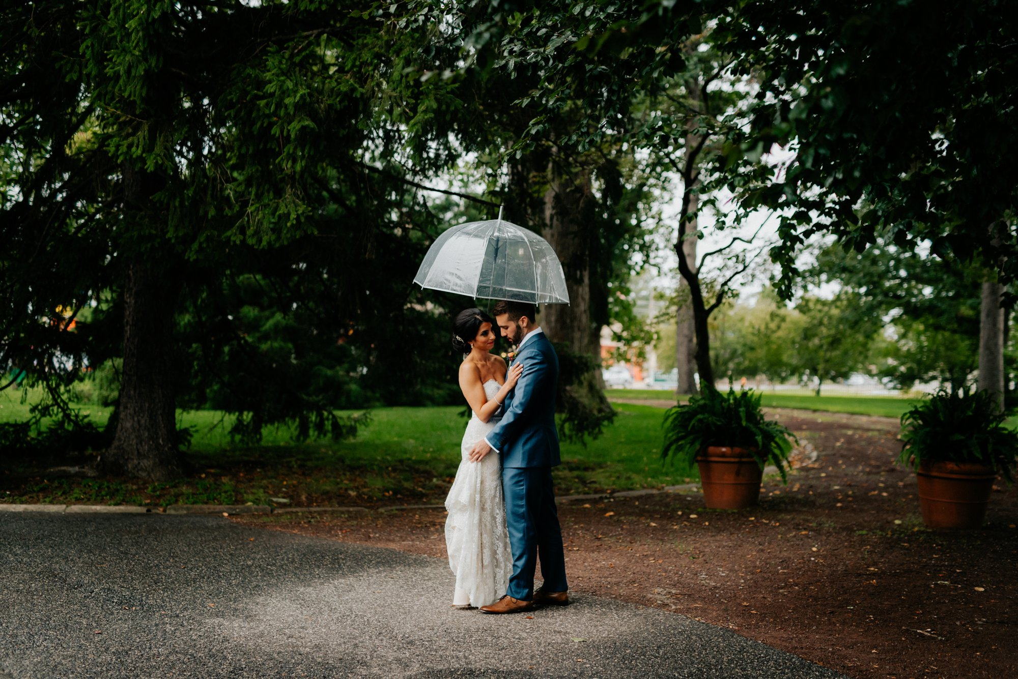 Lush Rainy Wedding at Knowlton Mansion in Philadelphia PA Moody Shadows and Umbrella Portraits