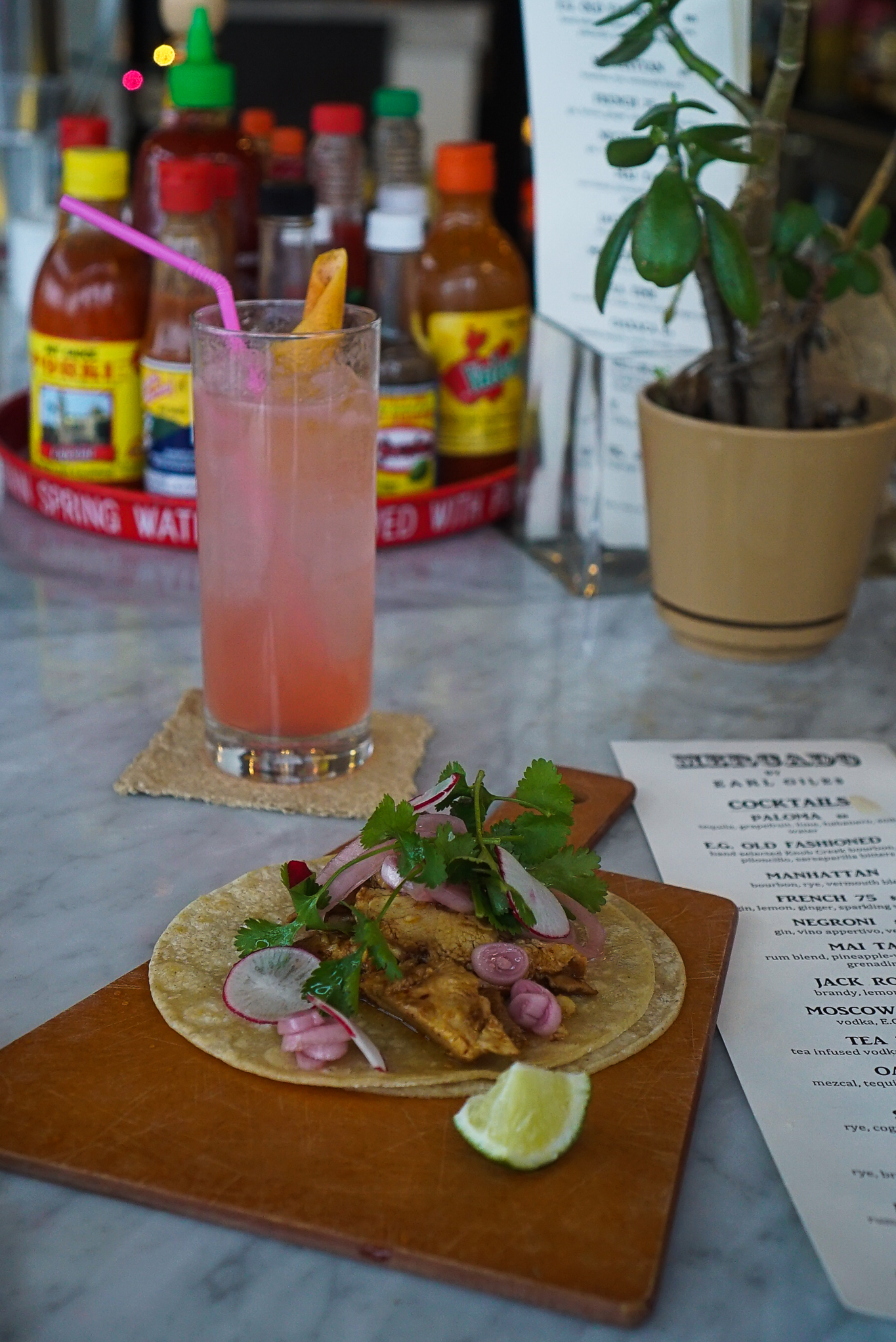 "A Paloma & ""Chicken Lady"" tacos at Mercado"