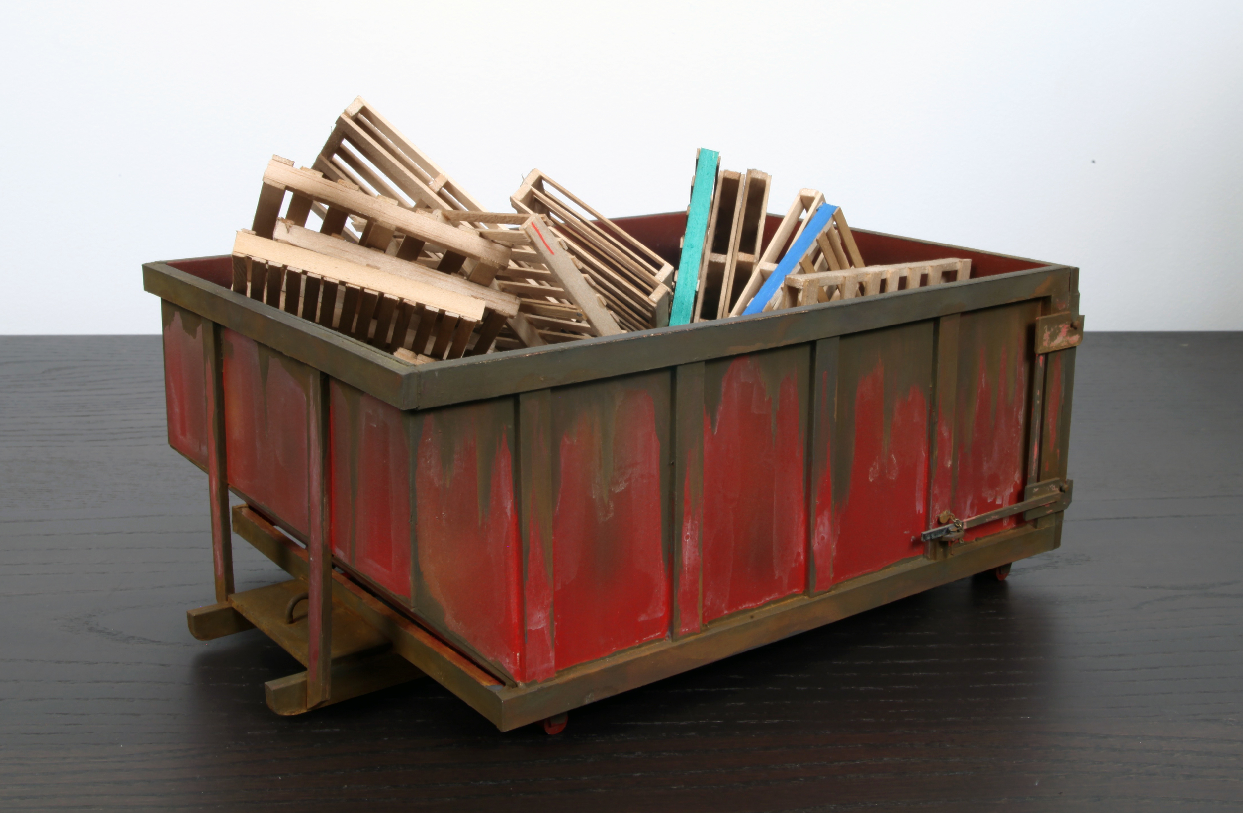 Red Dumpster with 30 pallets