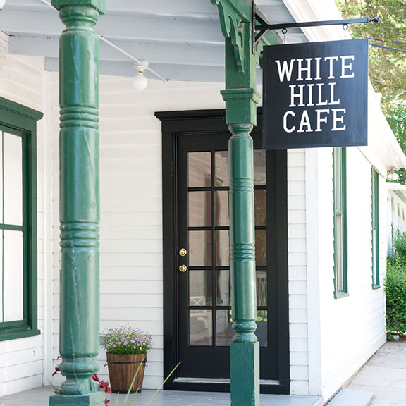 White Hill Cafe Sign in front of door