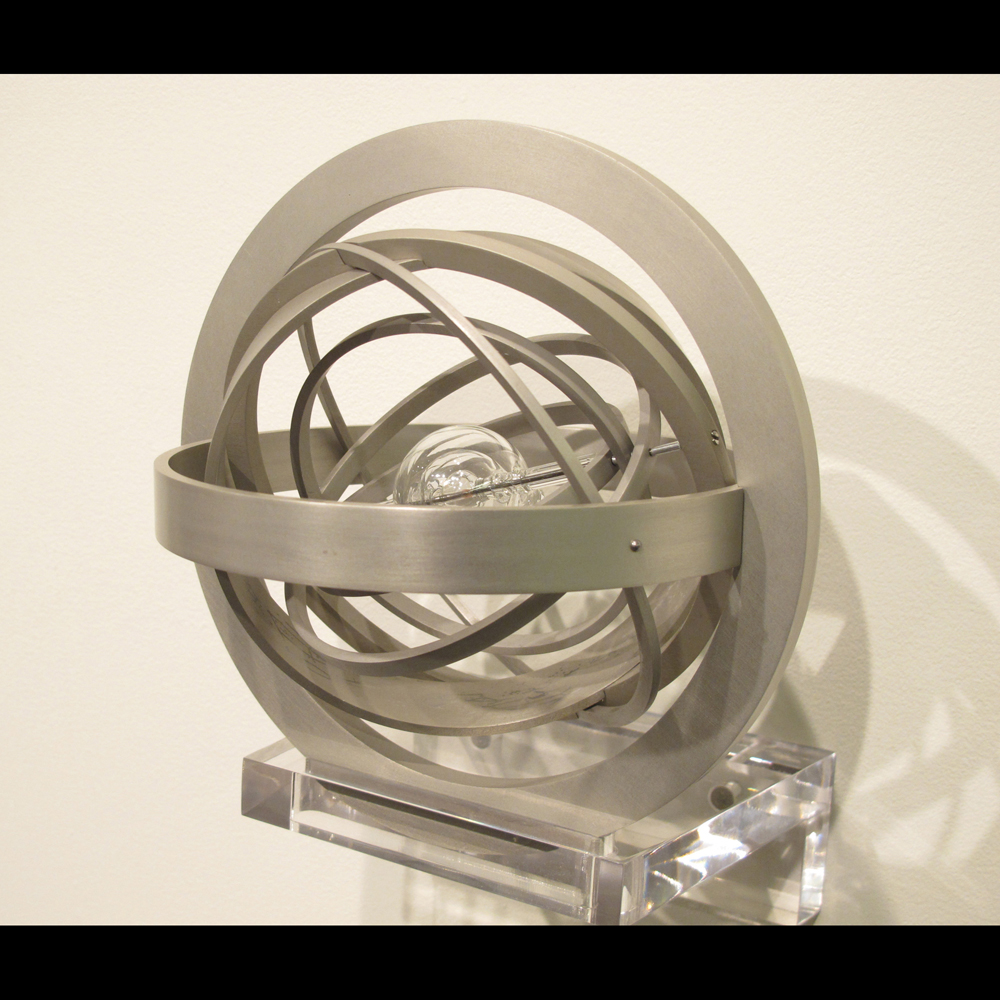 Armillary Sphere  (2011), 8x8x8 inches, aluminum and borosilicate glass
