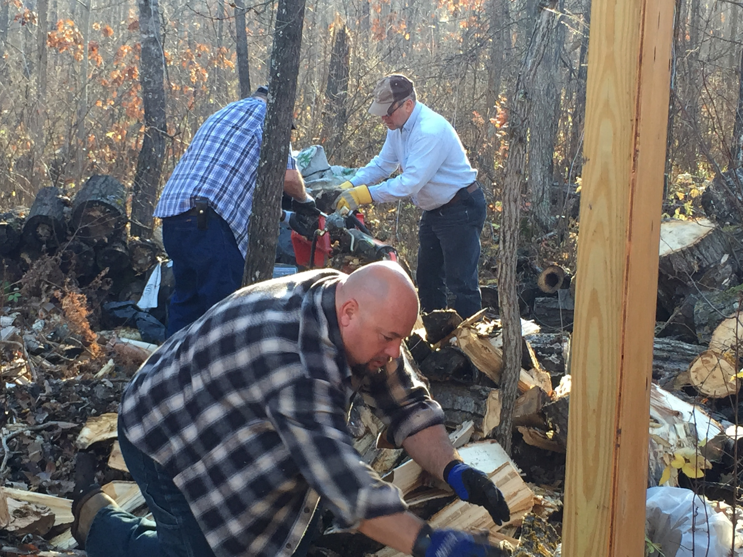 Bill, Larry, and George - working on the woodpile