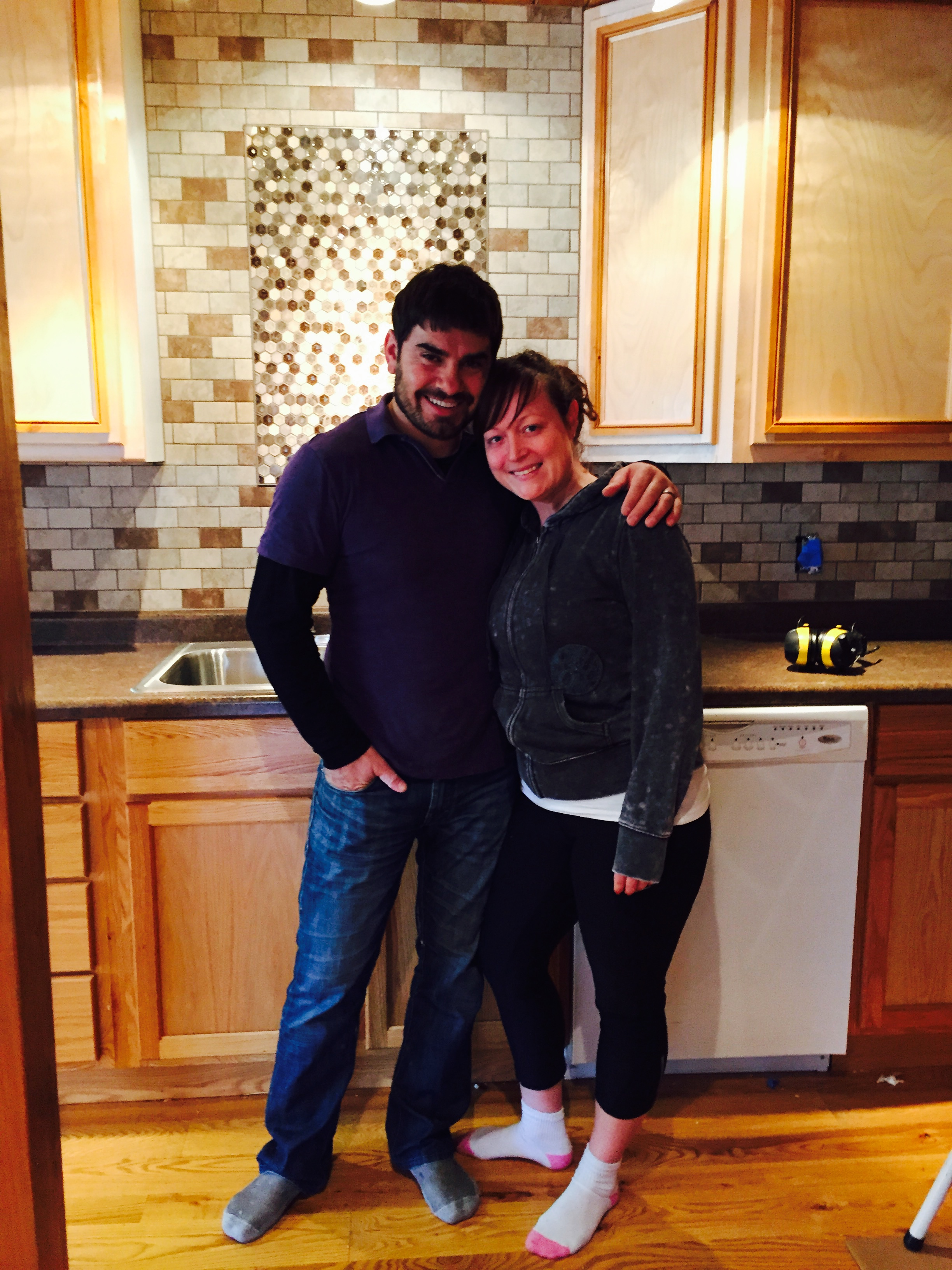 Benny and Jen Timony standing in front of newly installed backsplash!