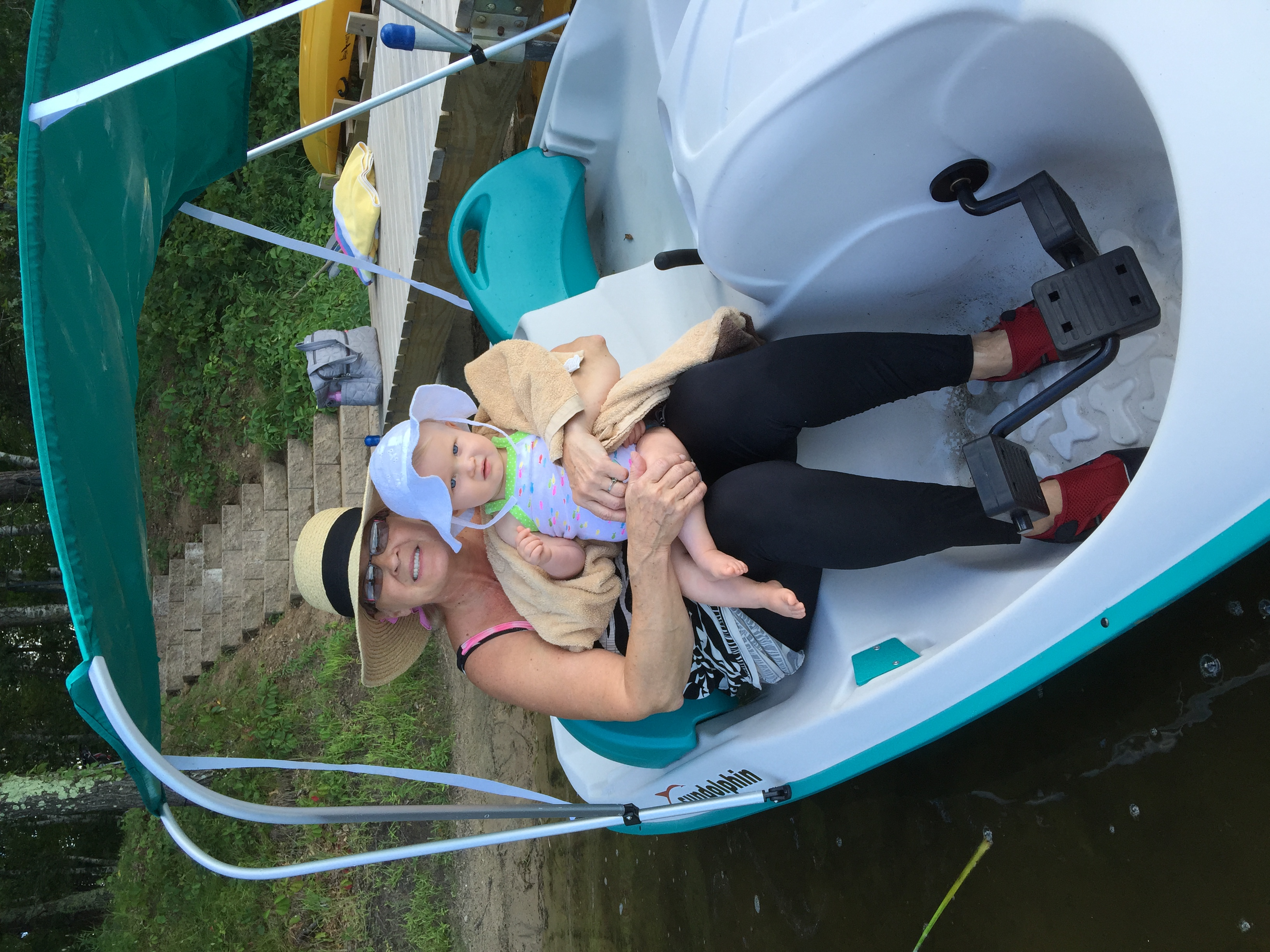 Here's Judy sitting in our new paddle boat with our youngest granddaughter who was visiting with us.