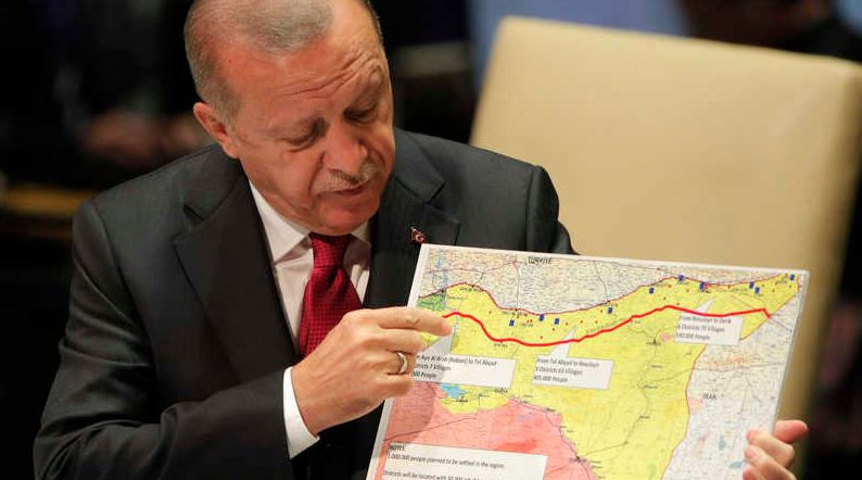 "President Recep Tayyip Erdogan shows off a map of his proposed ""safe zone"" in Kurdish-majority Northeastern Syria during his address to the UN General Assembly on Sept. 24, 2019 (Credit: Brendan Mcdermid, Reuters)"