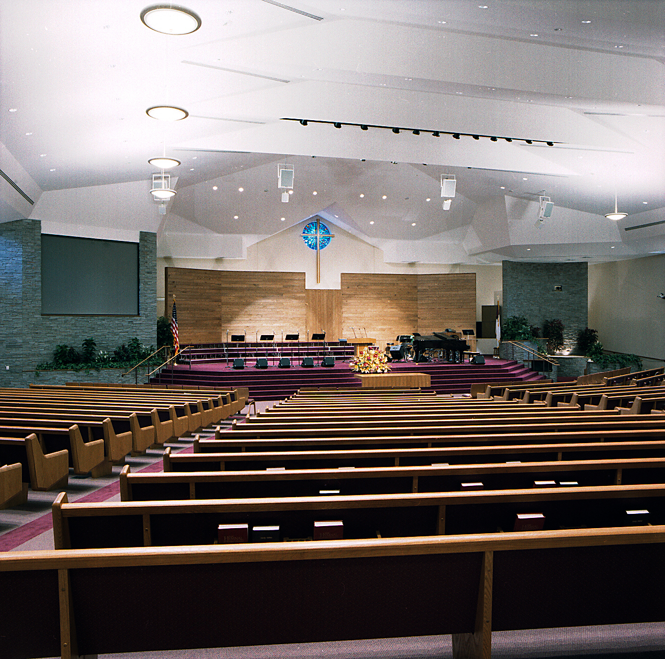 a more traditional evangelical congregation, loudonville community church nearalbany, ny wanted a space to accommodate both classical instruments and voice with natural (space) acoustics and amplified sound for contemporary worship. This900 seat space is equipped with State of the art Audio, video and lighting while preserving a more traditional 'church' appearance.