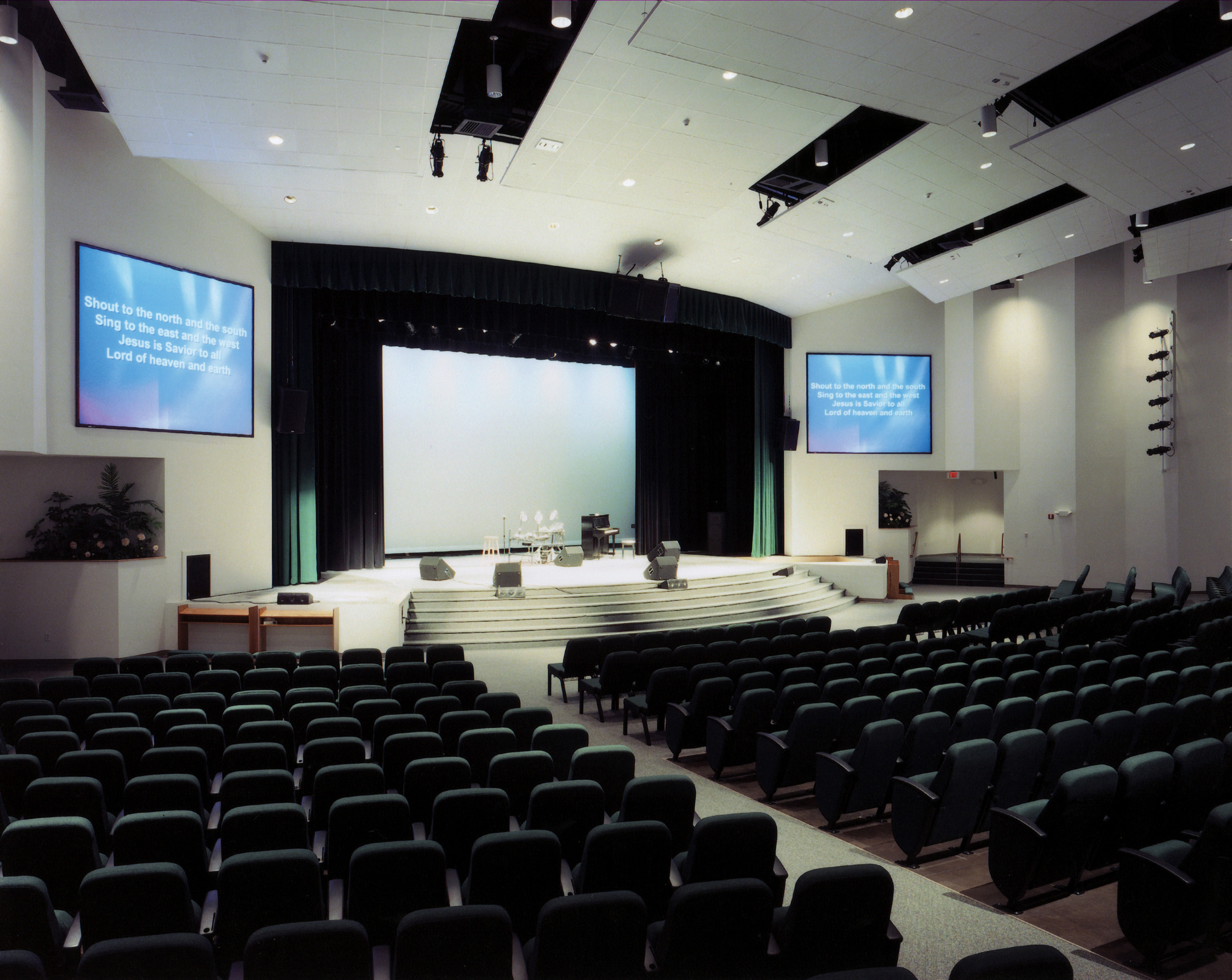 This expandable worship center designed for walnut hill community church inbethel, CT. has the unique feature of a 3-part floor. the front most section is flat to accommodate round tables for dinner-theater productions, while the central band os seats is on a sloped floor, and the expansion section (Removable back wall) is amphitheater seating. Total capacity 1,400 seats.