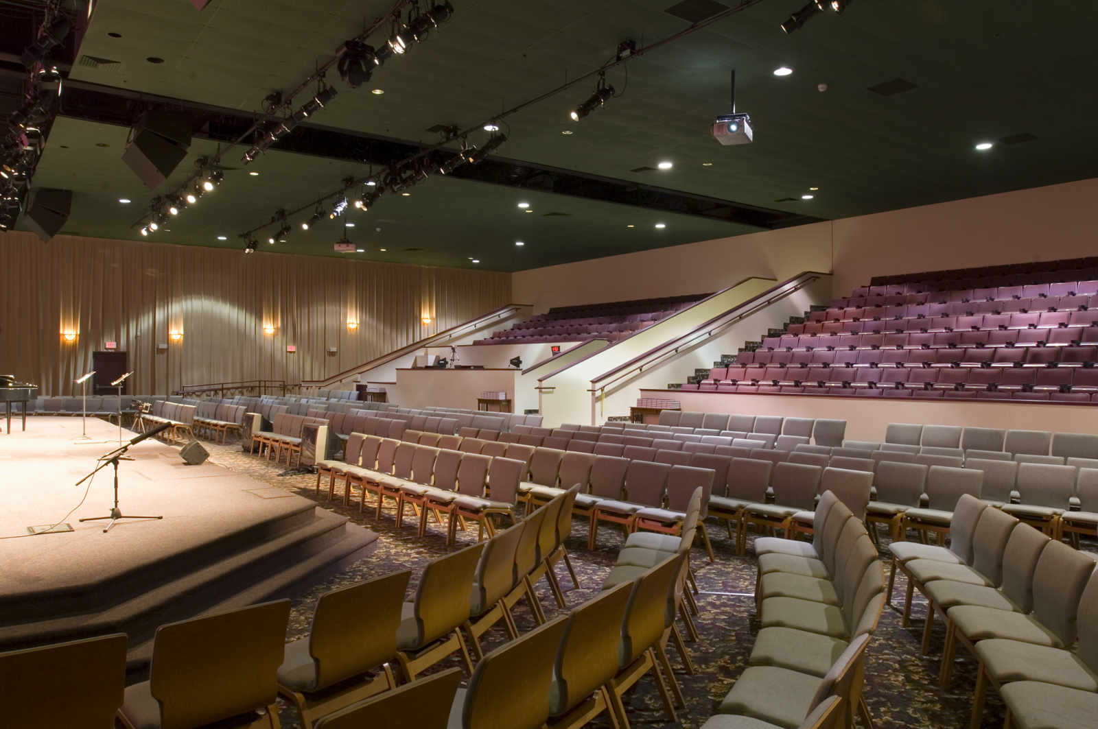 a very unique adaptive reuse, bethel, the church at franklin mills, occupies a former multi-plex cinema. this phase 1 auditorium combined two theaters to create a600 seat phase 1. two more vacant theaters on either side will providean additional 600 seats in a semi-circle arrangement for a total capacity of1,200