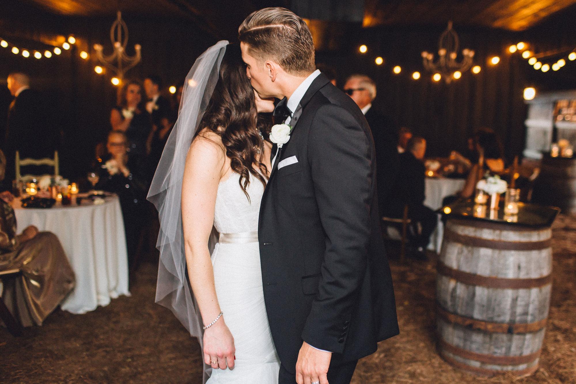 Me & Mr. Jones Wedding, Cocktail Hour in the Barn, Black Tie Wedding, Rustic Glam Wedding, Bourbon Barrel Cocktail Tables, Ballet Length Veil