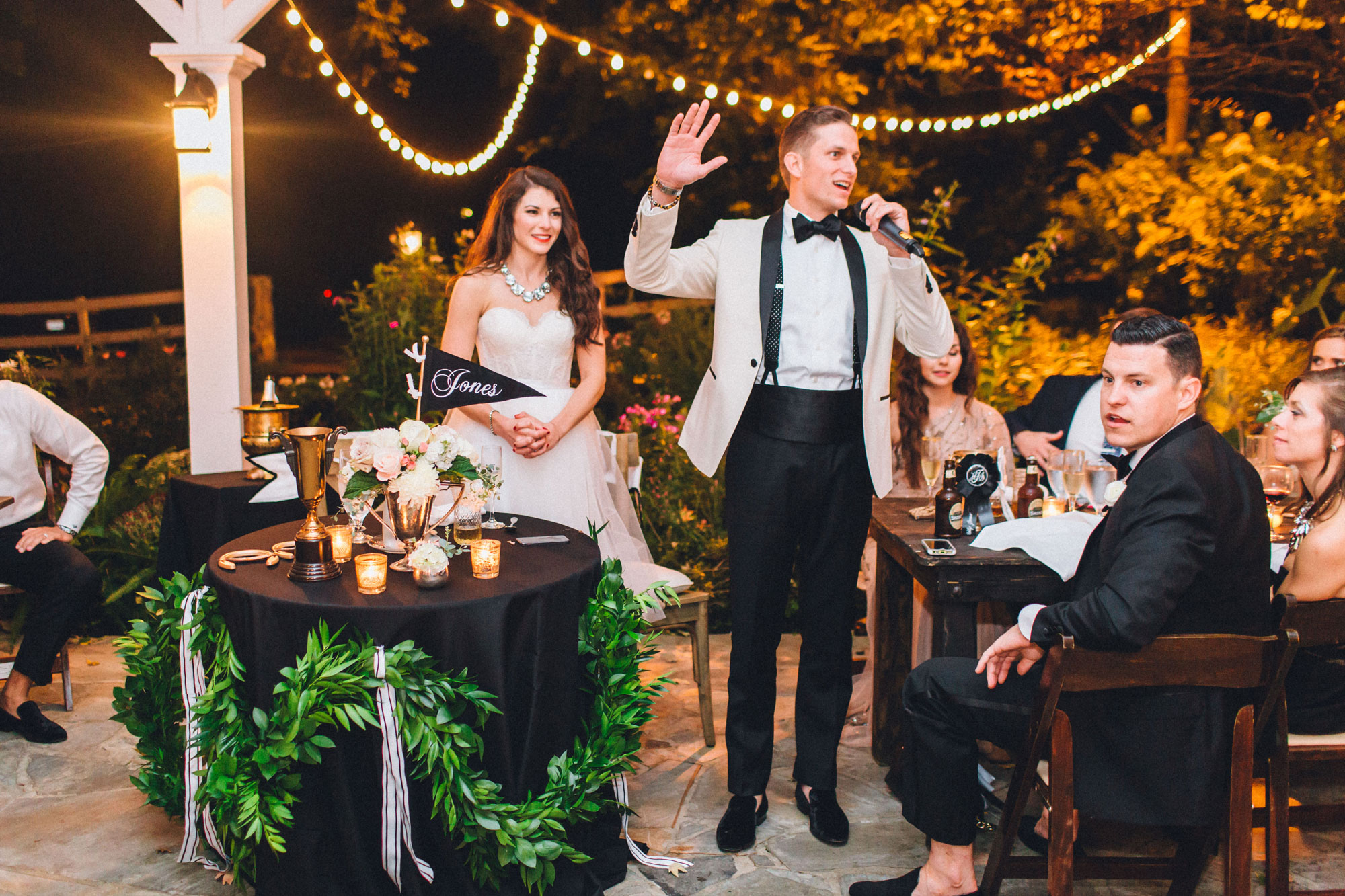 Me & Mr. Jones Wedding, Groom Thanking Guests, Table with Greenery, Black Tablecloths, Farm Tables, Rustic Glam Wedding Decor