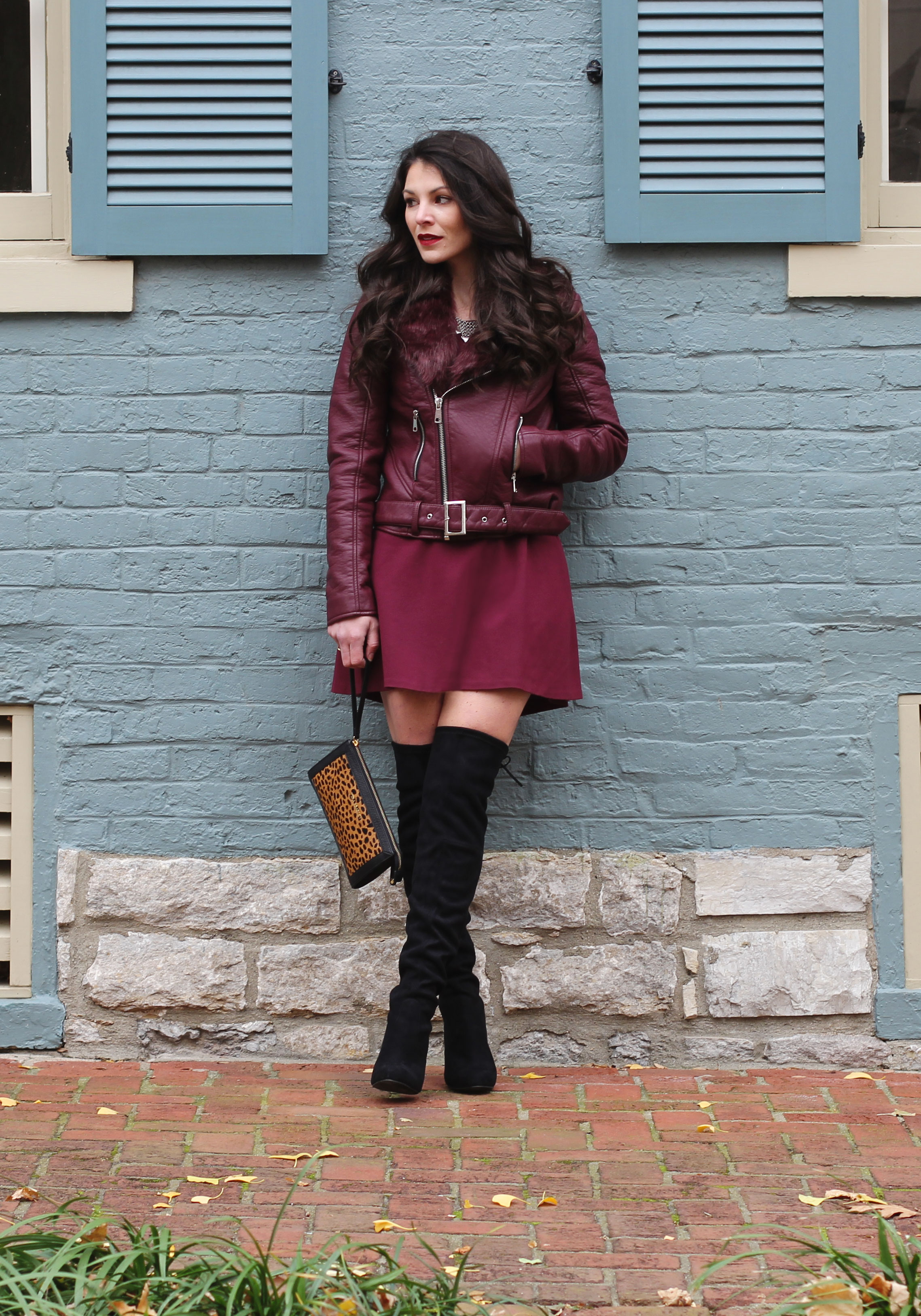 Holiday Outfit, Winter Fashion, Maroon Moto Jacket, Marsala Skater Dress, Steve Madden Gorgeous Over The Knee Boots, Vera Bradley Calf Hair Wristlet, Jenny Bird Necklace