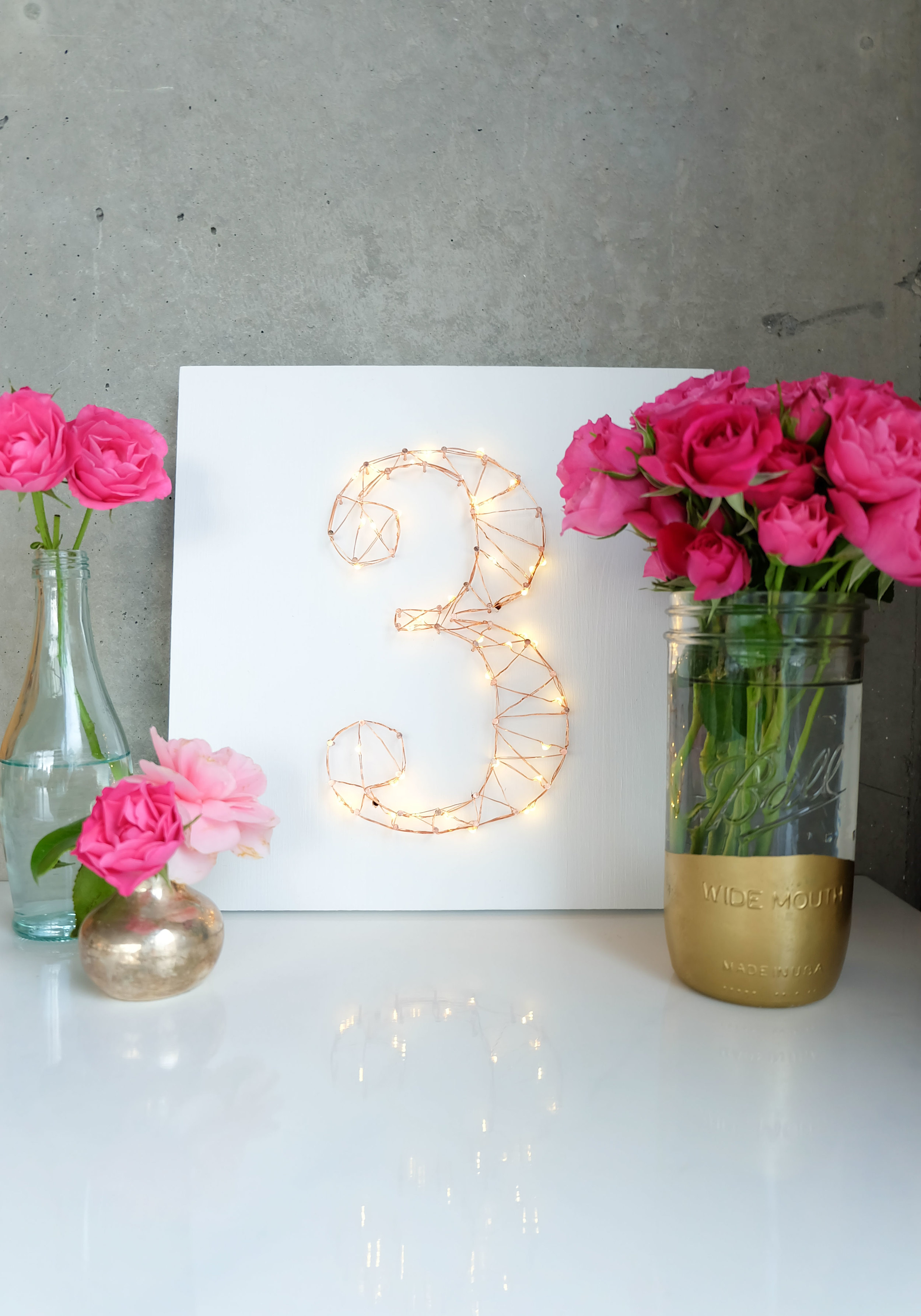 Inexpensive DIY light up wedding table numbers that double as wall art!