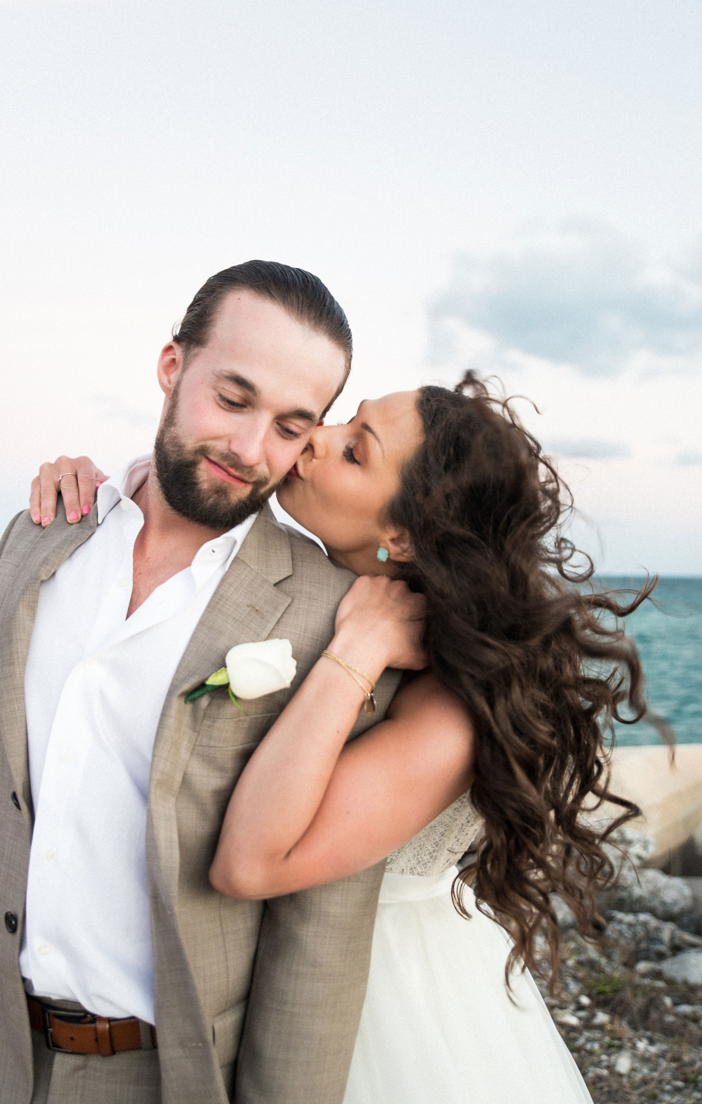 Destination wedding in Playa Mujeres Mexico.  Wedding on the beach wearing bridal separates.