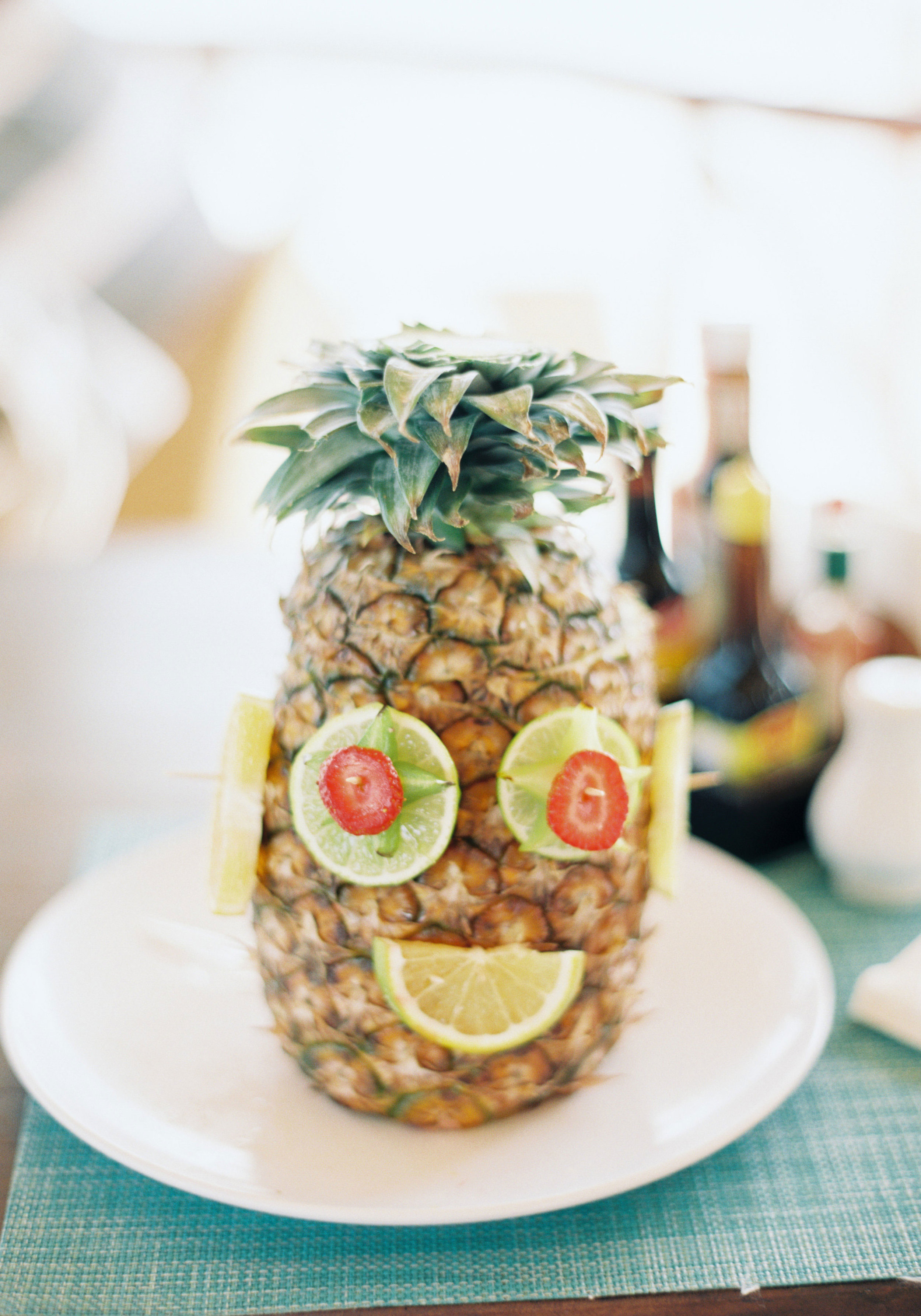 Mexico destination wedding, Pineapple drink decorating before the wedding, Wedding on the beach. www.me-and-mrjones.com