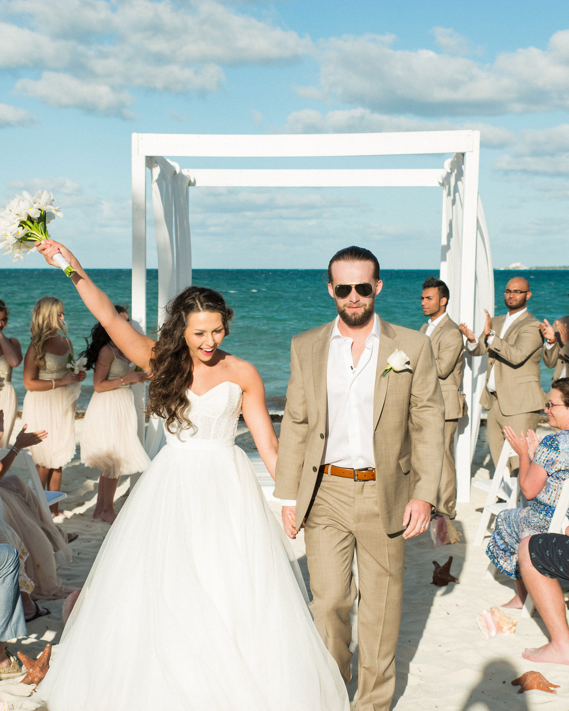 Destination wedding on the beach in Mexico, Bridal separates, Watters Ashan skirt, Simple white bouquet.