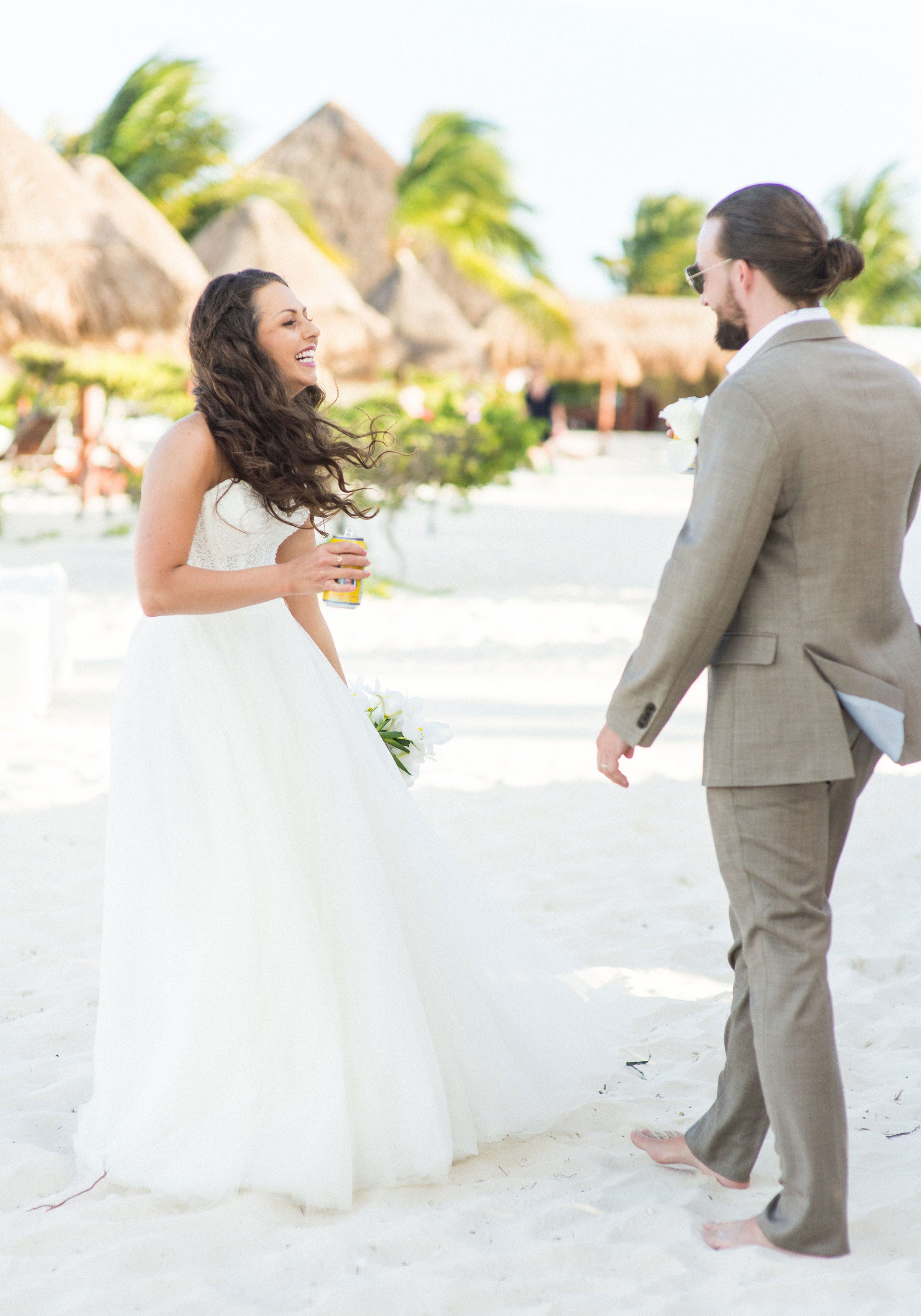 Bride & Groom at their cocktail hour on the beach.  Destination wedding in Mexico.