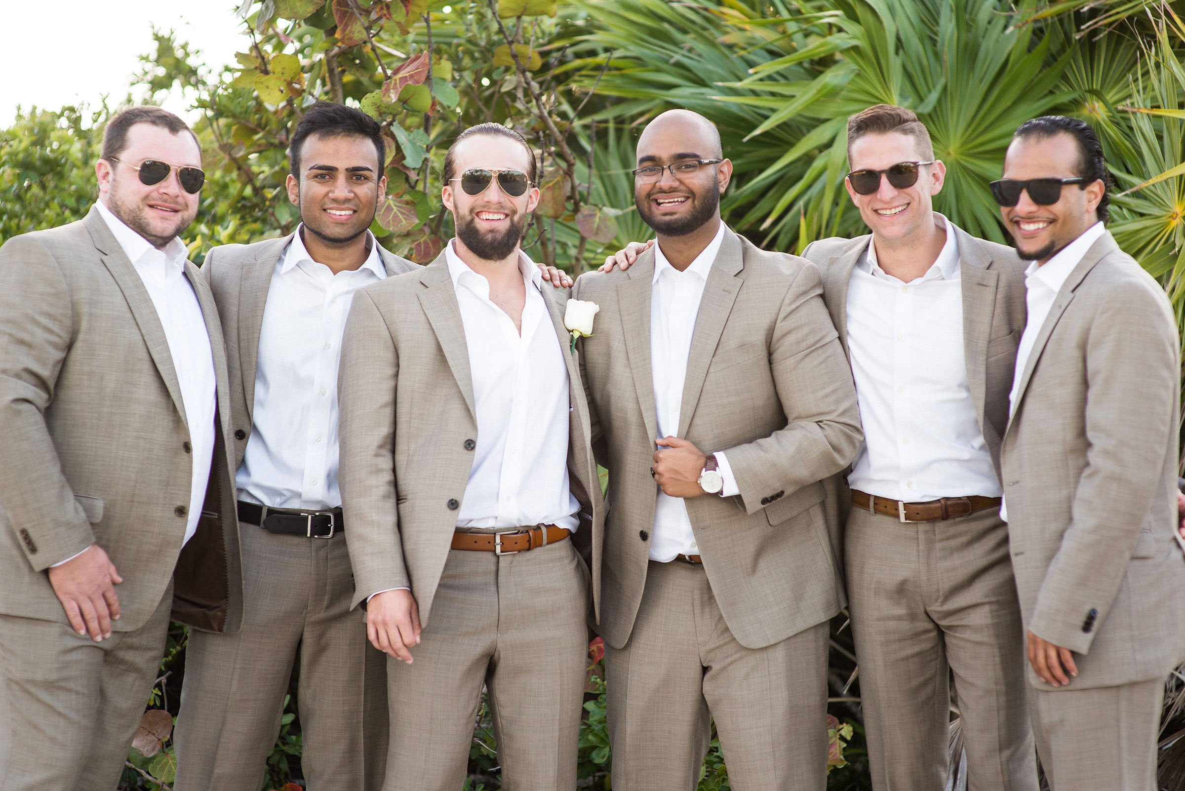 Groom and groomsmen in tan suits for beach wedding.  Destination wedding in Mexico.