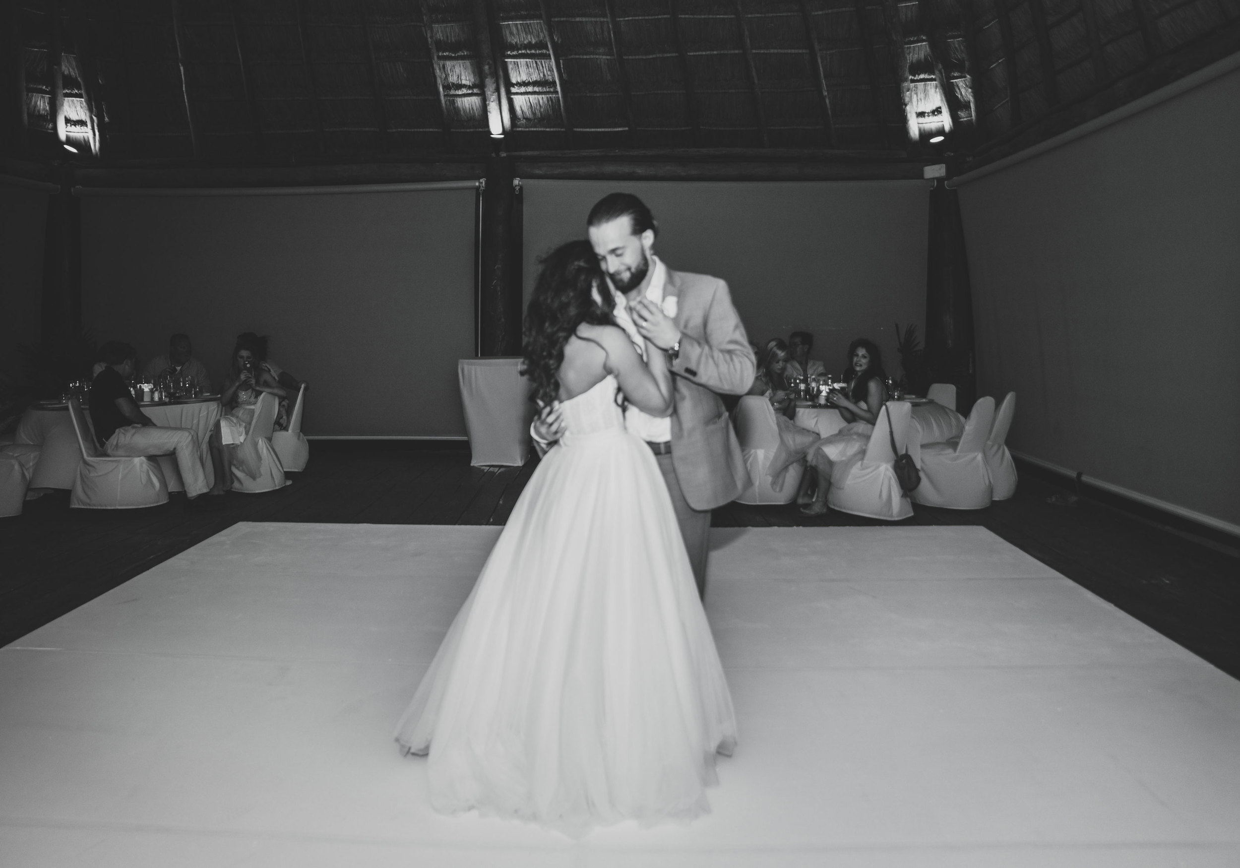 Destination wedding in Mexico, bride and groom's first dance, Groom with a man bun.
