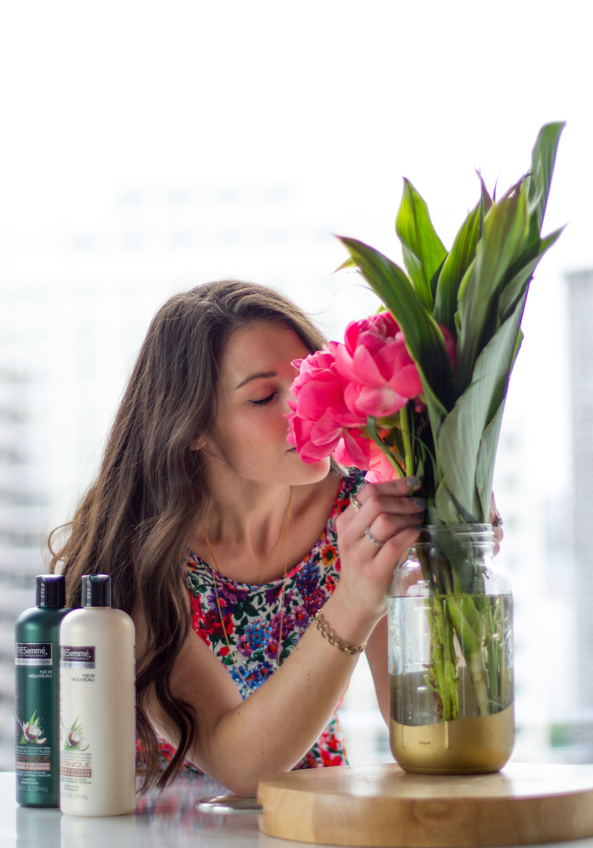 Inexpensive Tresemme Shampoo & Conditioner that smells amazing! Pink peonies with tropical leaves.  Tropical flower arrangement.