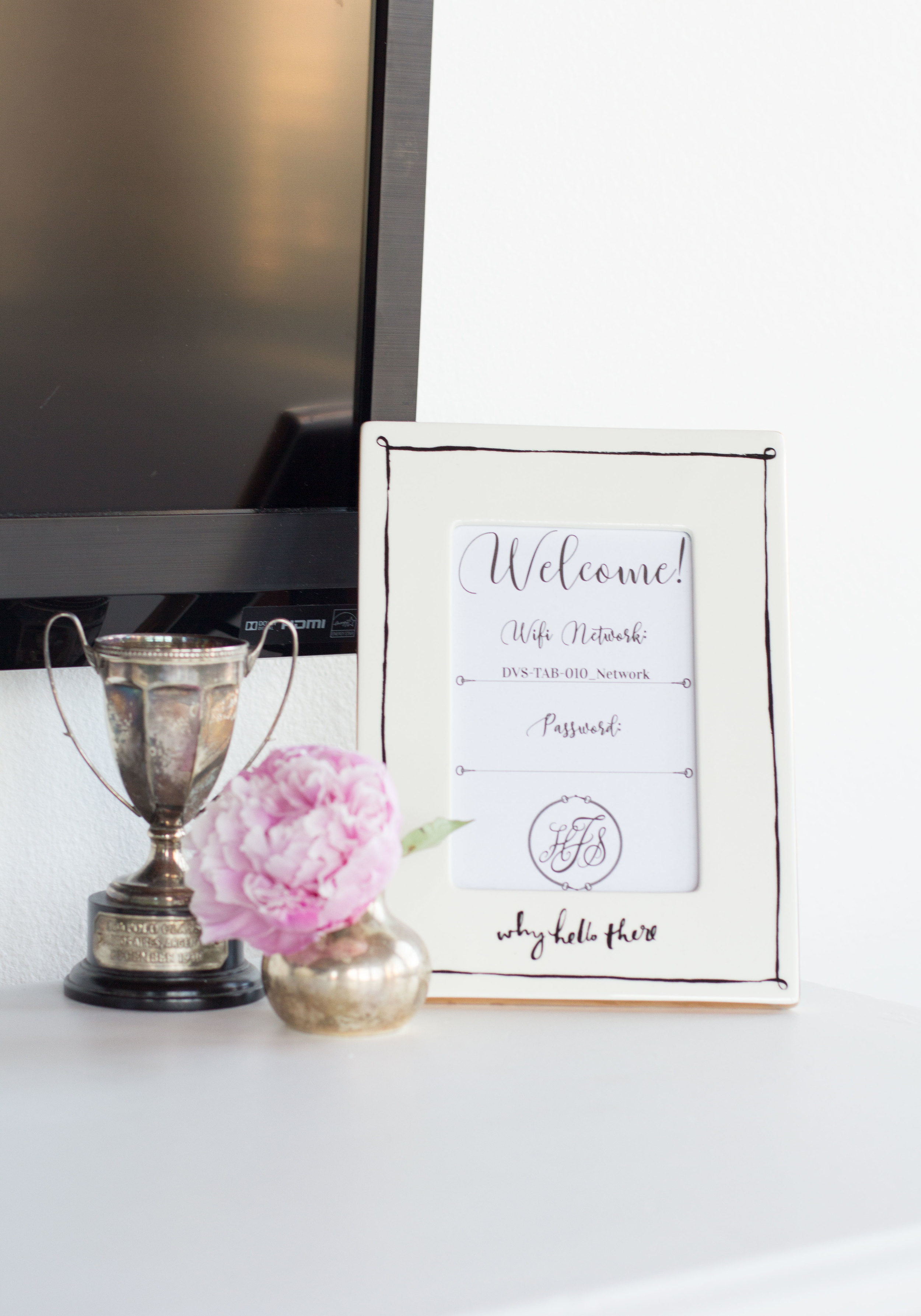 """Framed wifi password for guest bedroom or living room.  Kate Spade """"why hello there"""" picture frame."""
