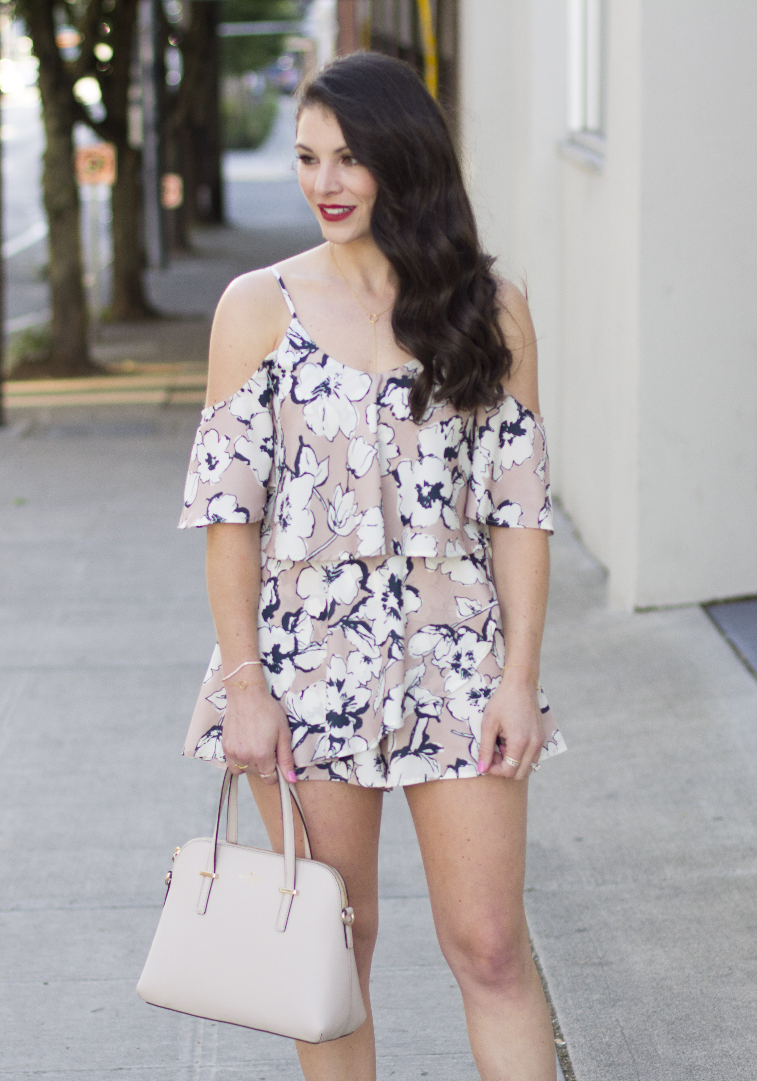 Summer date night outfit, JOA floral print cold shoulder romper, Steve Madden Rizzaa sandals, Kate Spade Cedar Street Maise, J.Crew denim jacket with DIY embellishment, statement earrings, and NARS red lipstick!