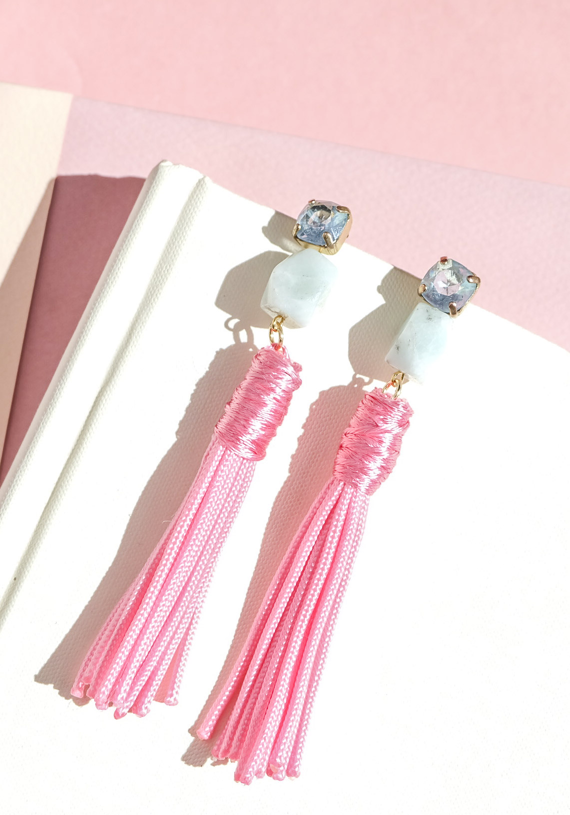 DIY tassel statement earrings similar to Baublebar Piñata earrings.  Pink tassel earrings for fall on www.me-and-mrjones.com