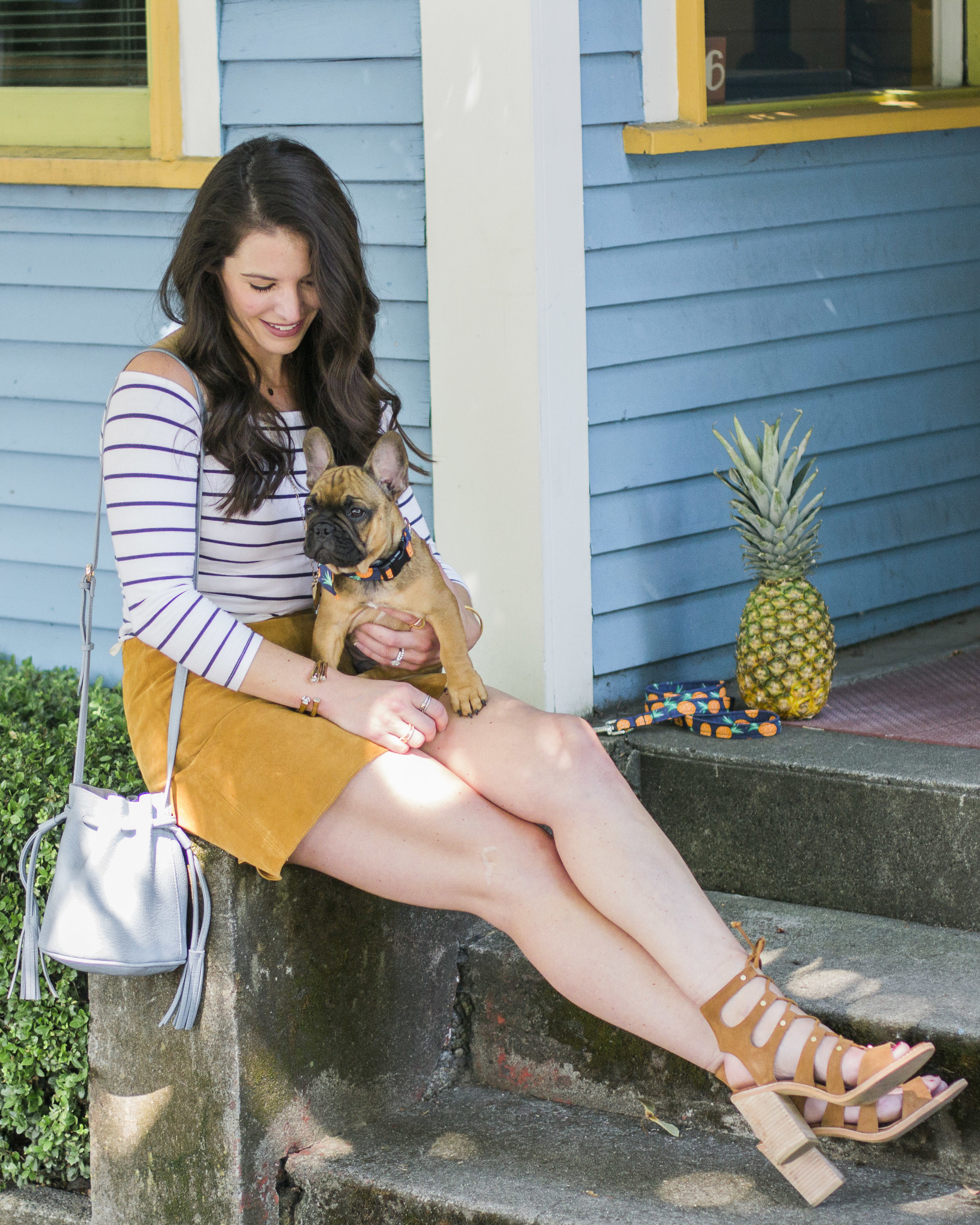Fall Transition Outfit, Suede skirt with off the shoulder 'Bardot' top, French bulldog puppy, red fawn frenchie, Dolce Vita Lyndon sandals.