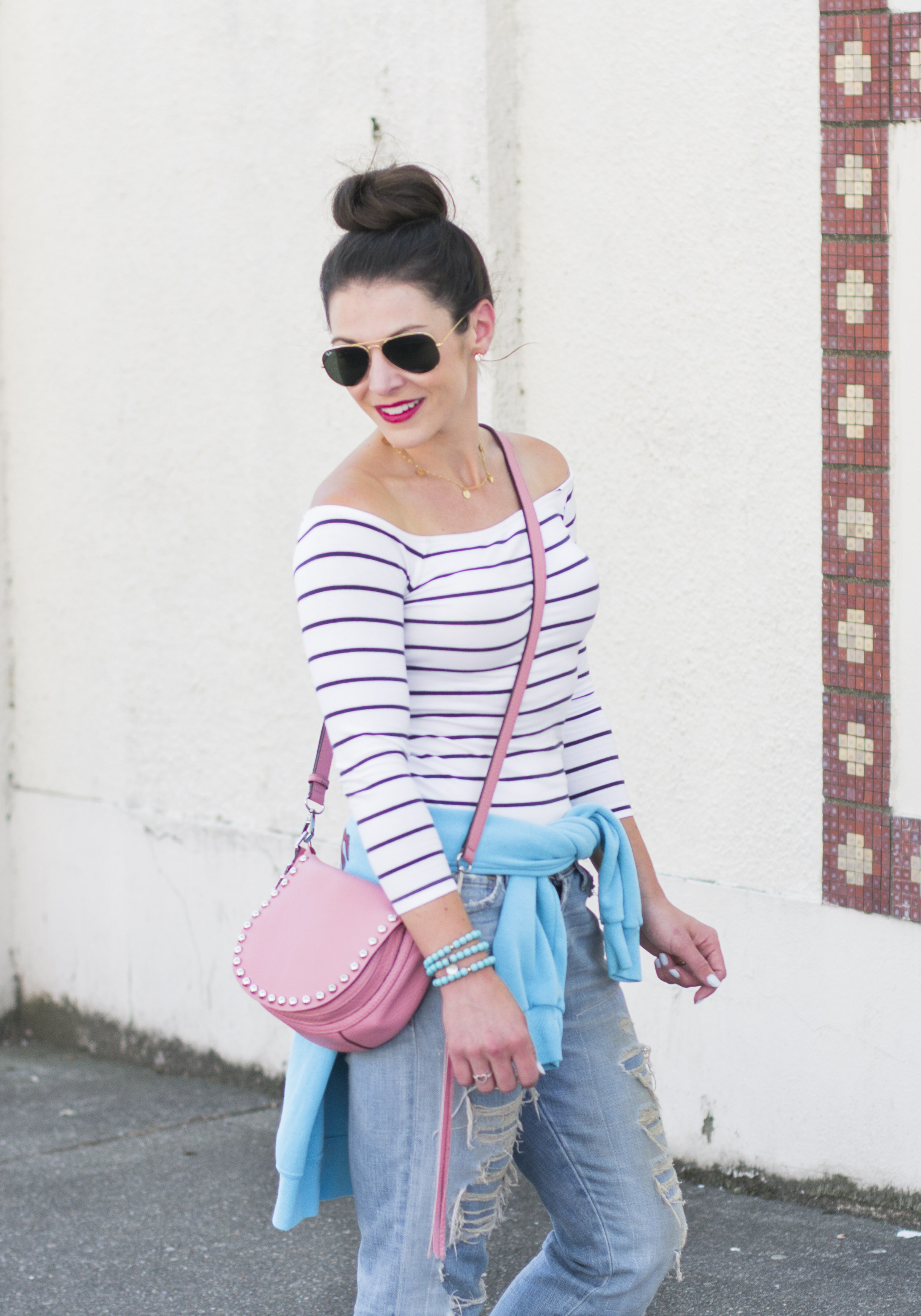 Save money on fall fashion by buying vintage clothing.  4 tips to find the best vintage pieces to save you money on fall apparel.  Boyfriend jeans, vintage baseball sweatshirt, off the shoulder top for fall, gladiator sandals, Rebecca Minkoff unlined saddle bag.